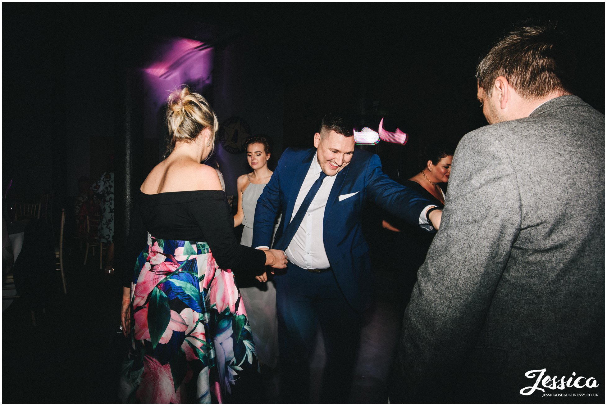 friends of the couple dance on the dancefloor