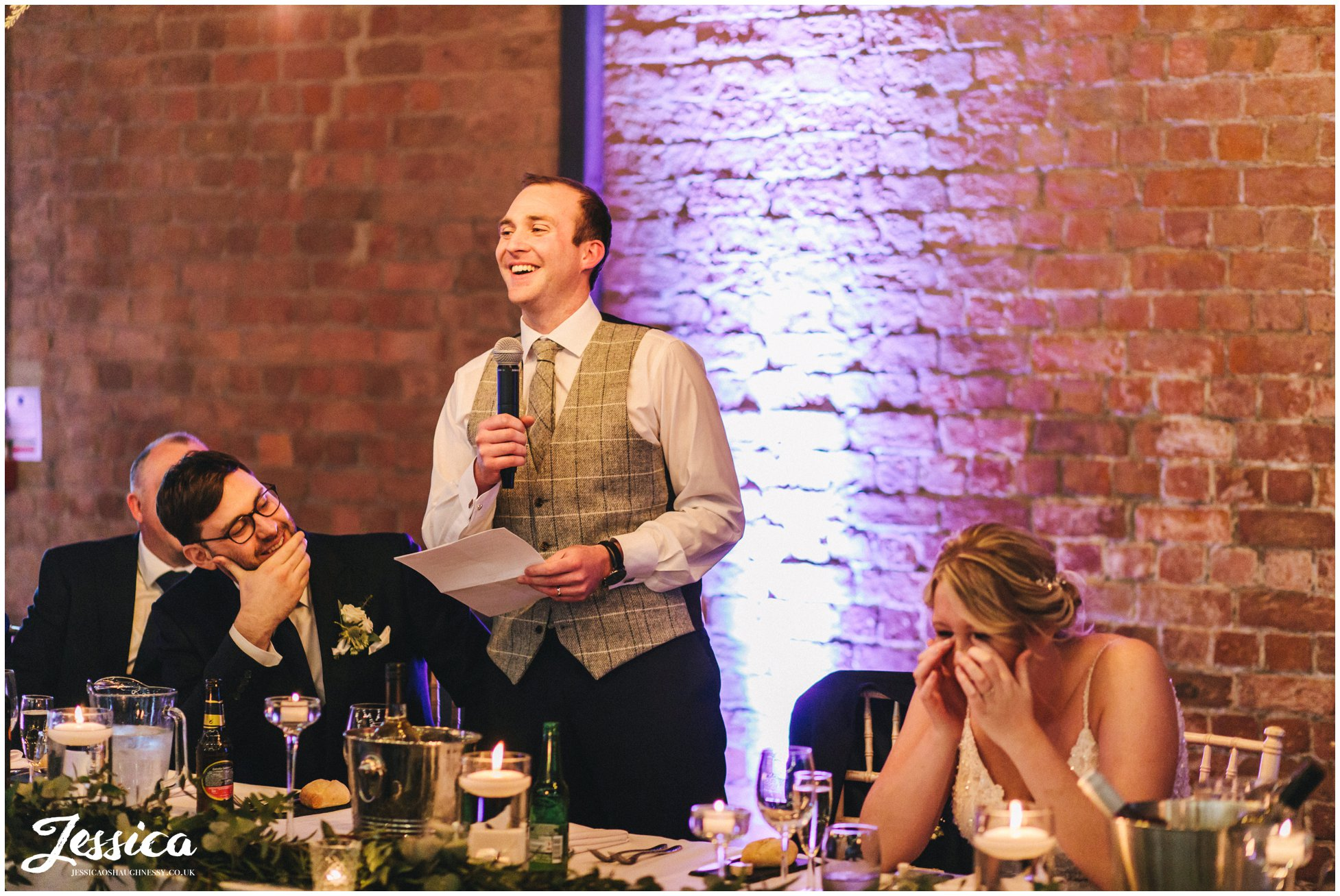 the groom stands to give his speech