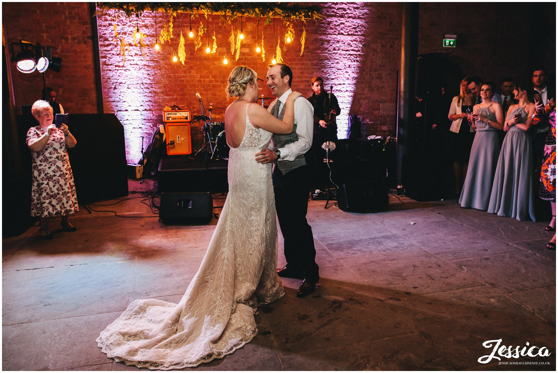 the couple share their first dance at the titanic hotel in liverpool