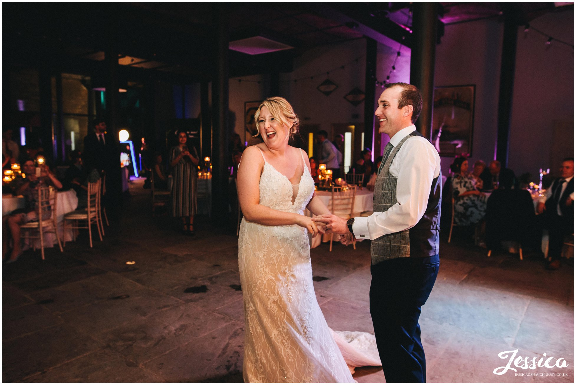 the newly wed's laugh during their first dance