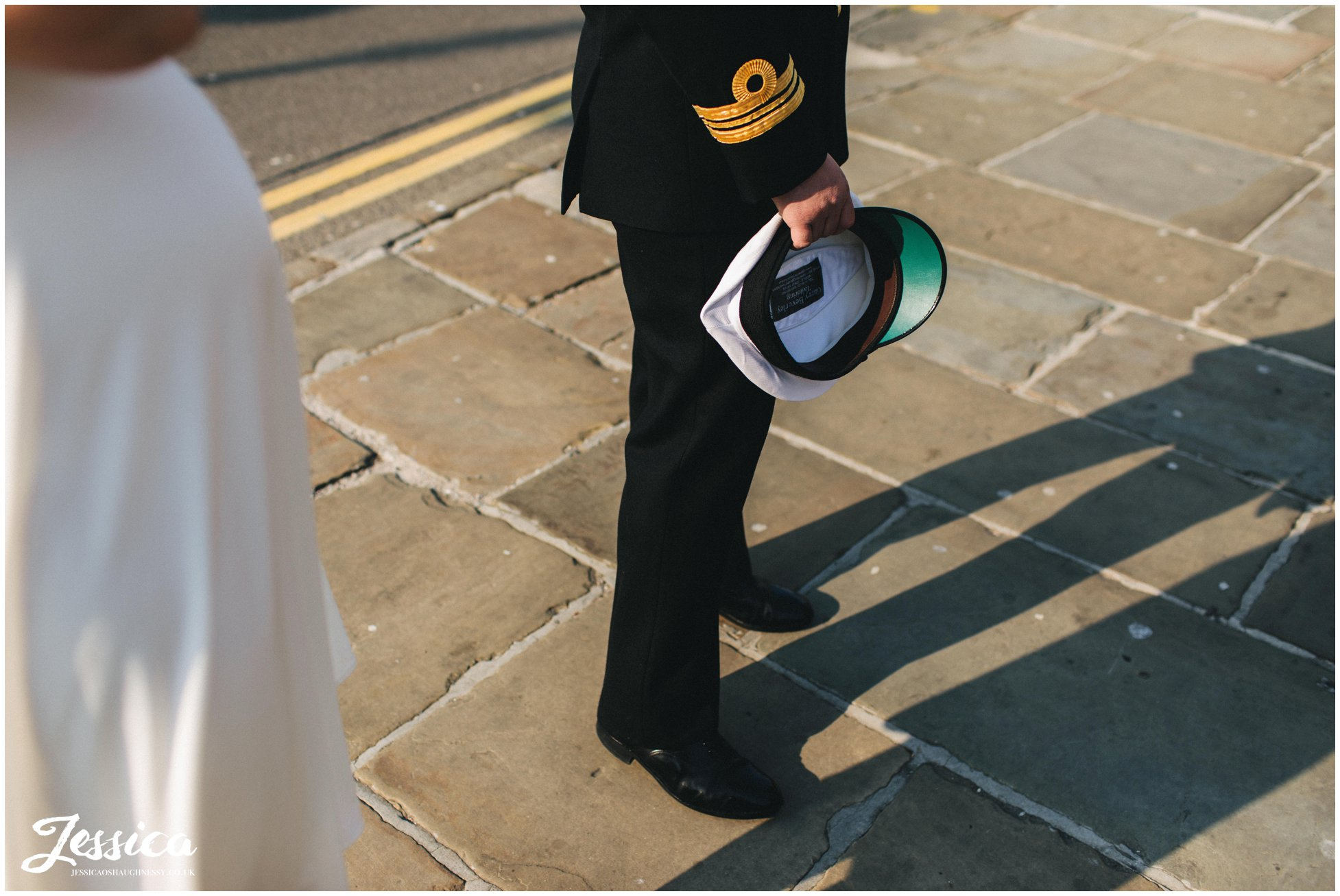 groom waits outside st georges hall before the ceremony