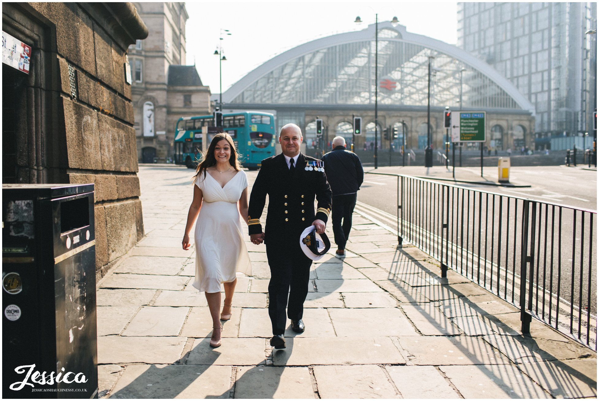 bride & groom walk into st georges hall in liverpool for their elopement ceremony