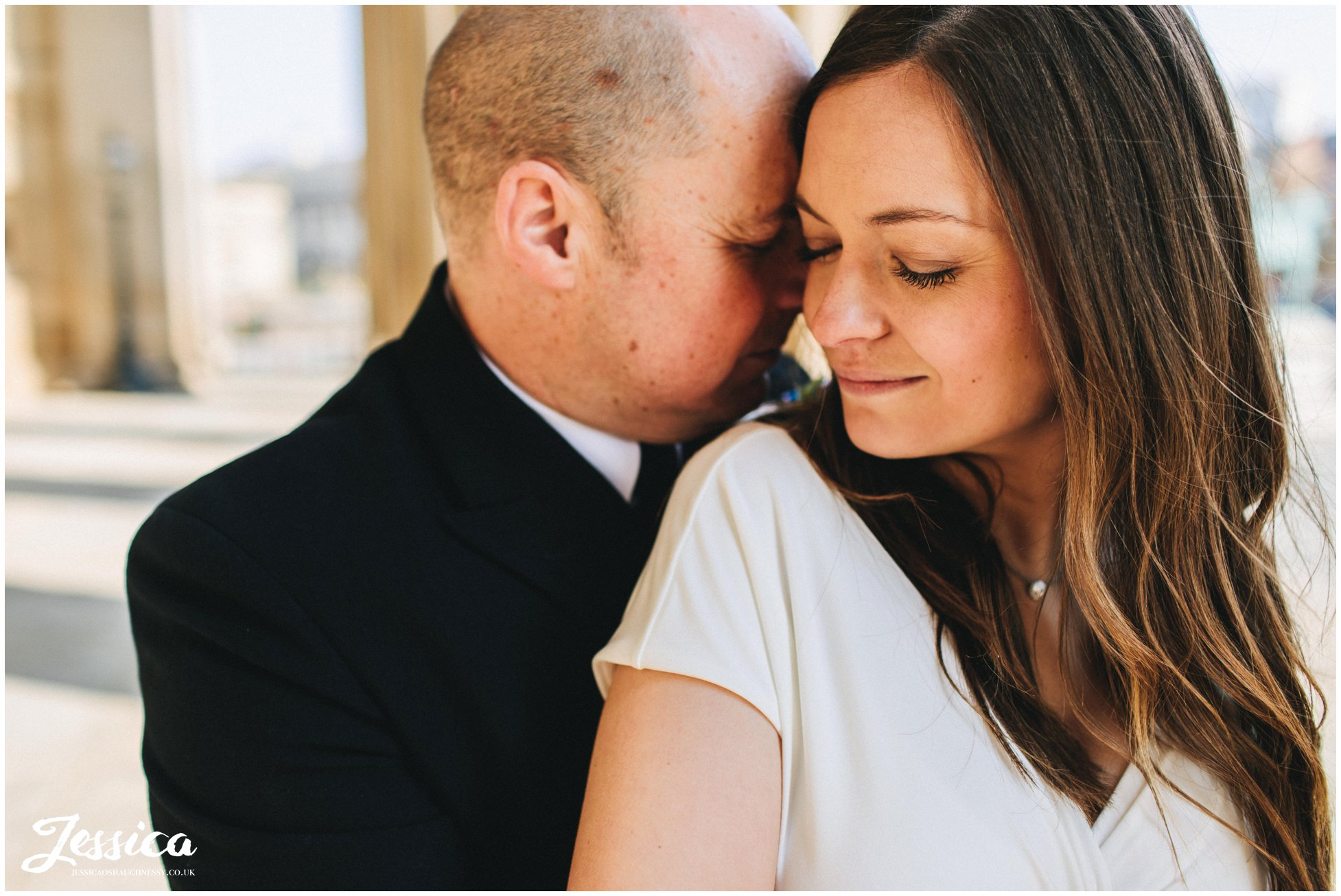 the couple hold each other after their liverpool elopement
