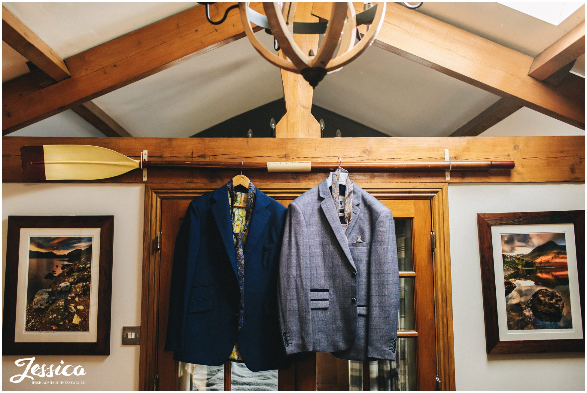 The groom's suits hang ready for their wedding