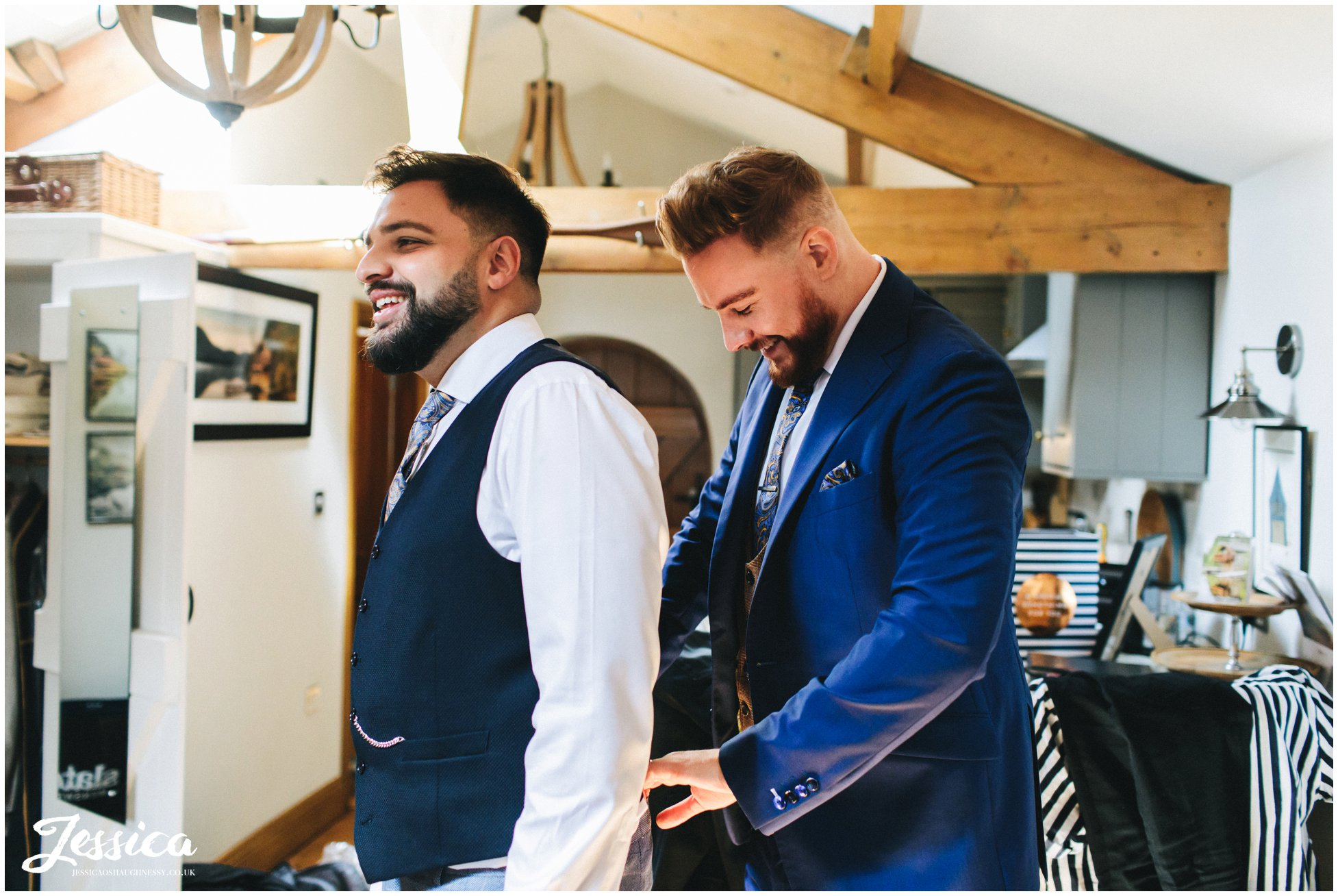the grooms get ready together ahead of their lake district wedding