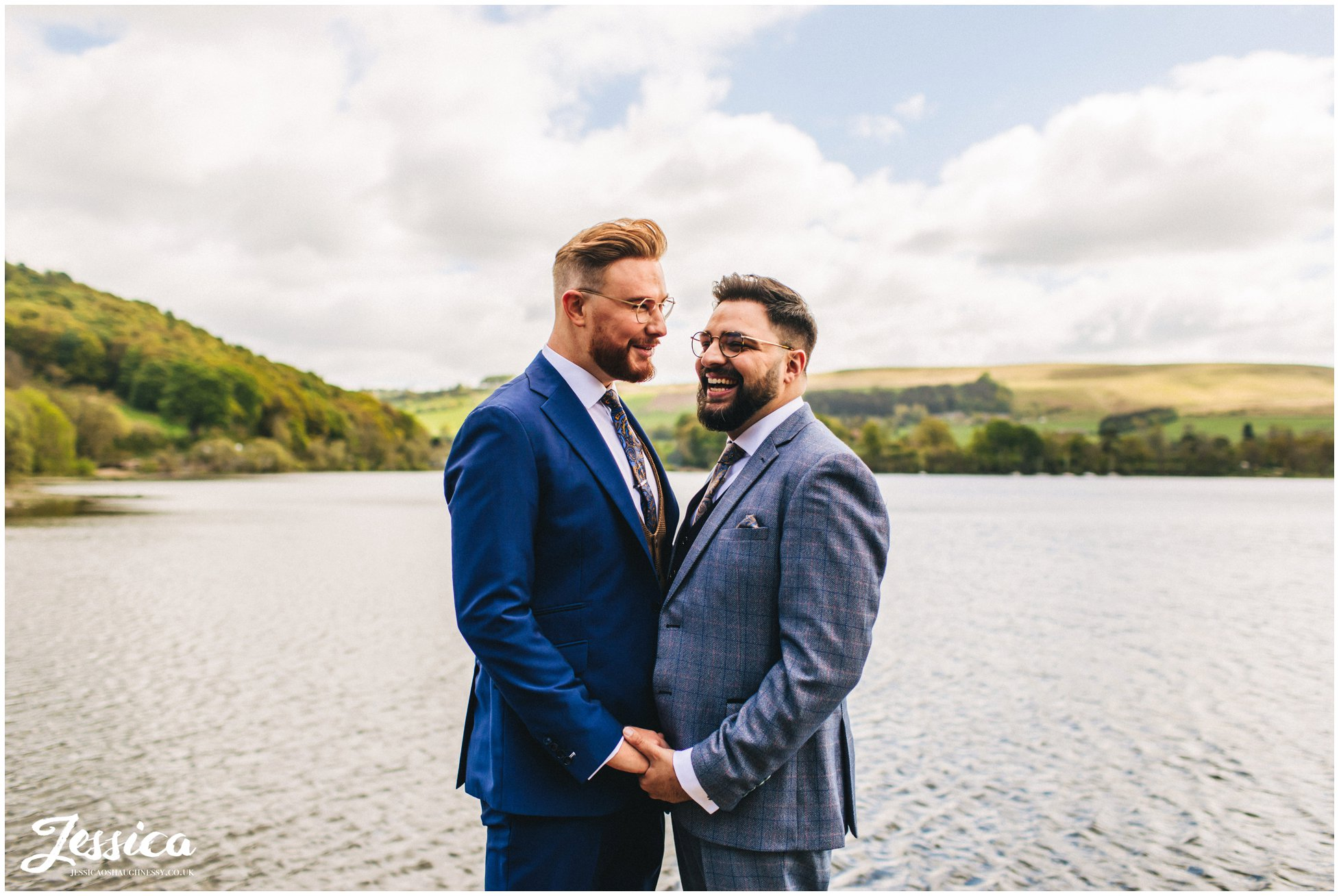 the grooms hold each other before heading to their ceremony in the lakes