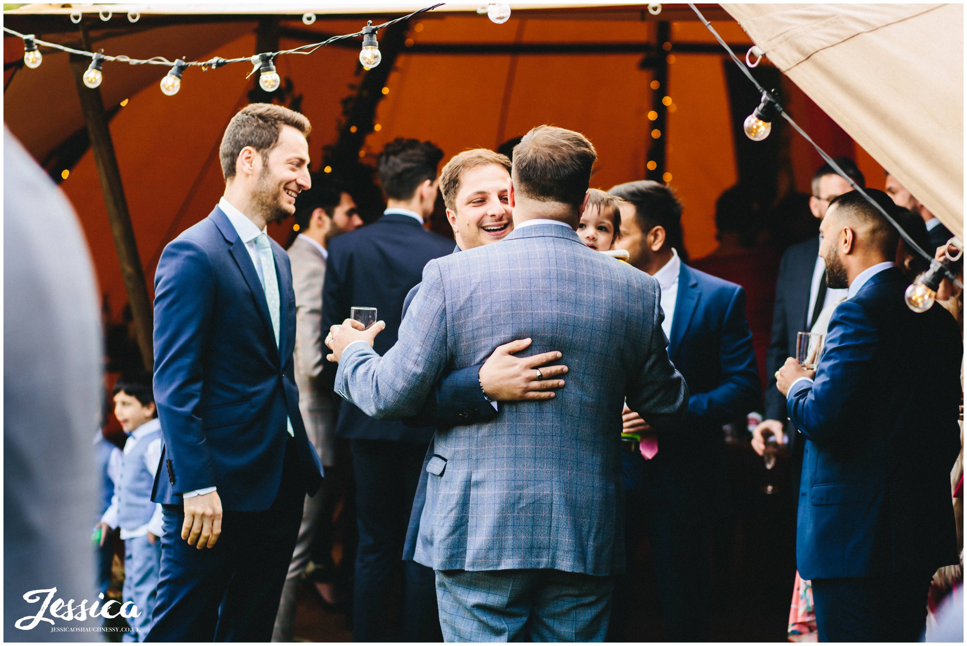 The grooms family greet him before the ceremony starts
