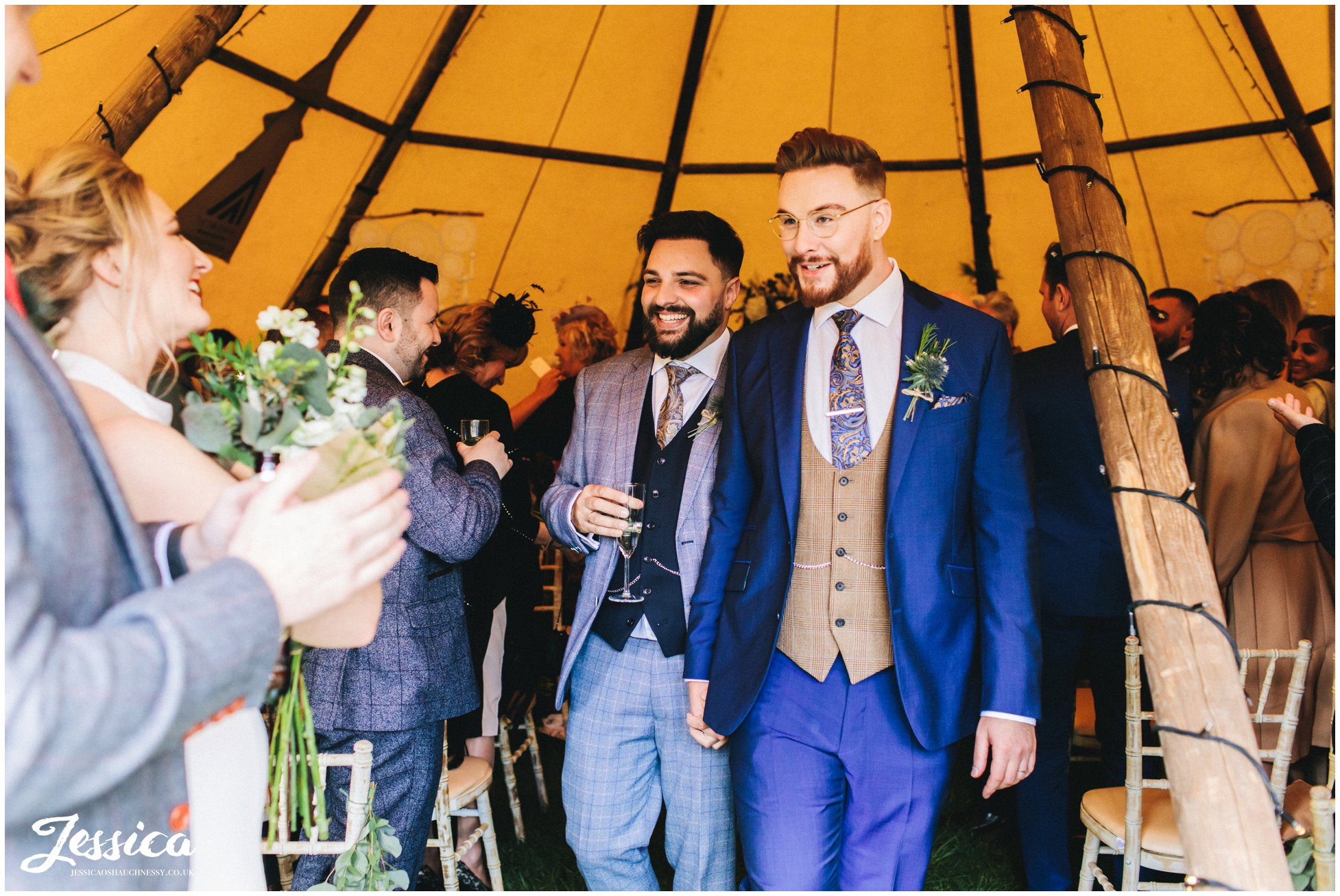 the newly wed's walk out of the tipi as husband and husband