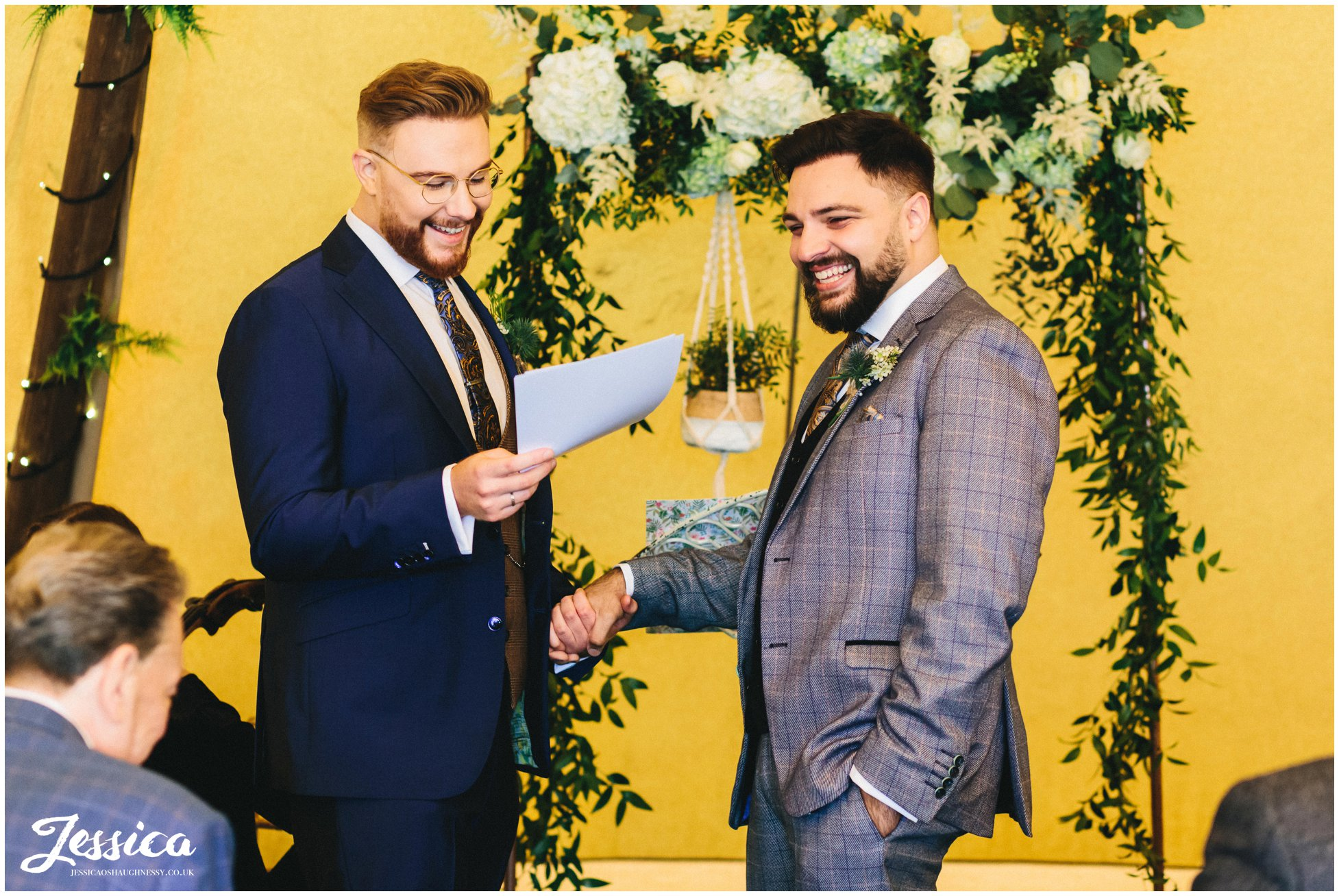 Grooms laugh whilst delivering their speeches