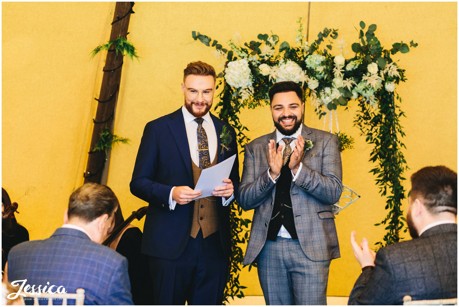 Grooms say their vows to each other at their lake district wedding