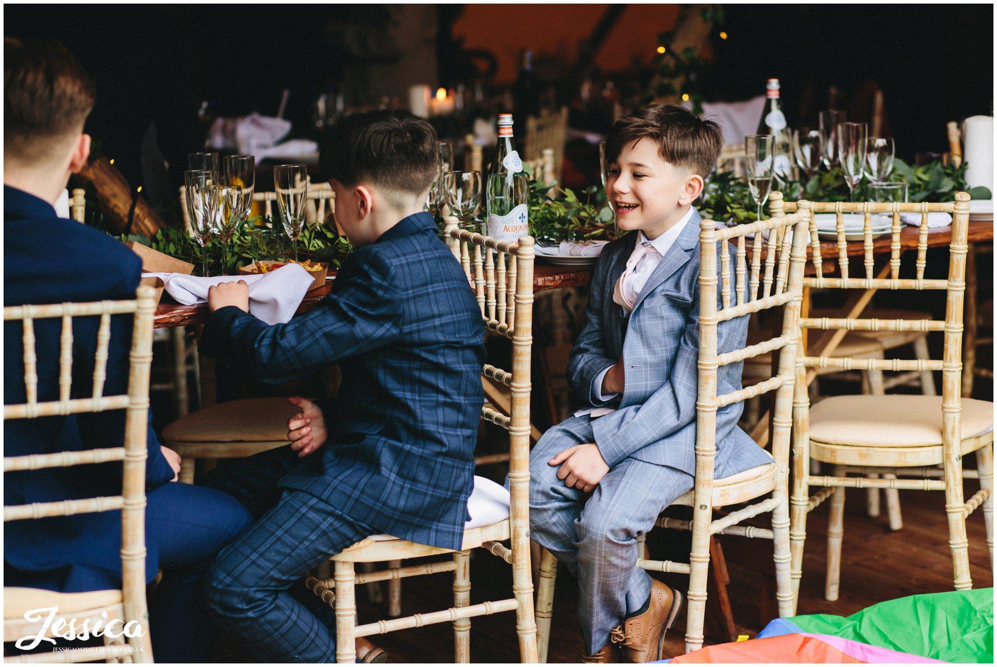 boys laughing during their wedding breakfast