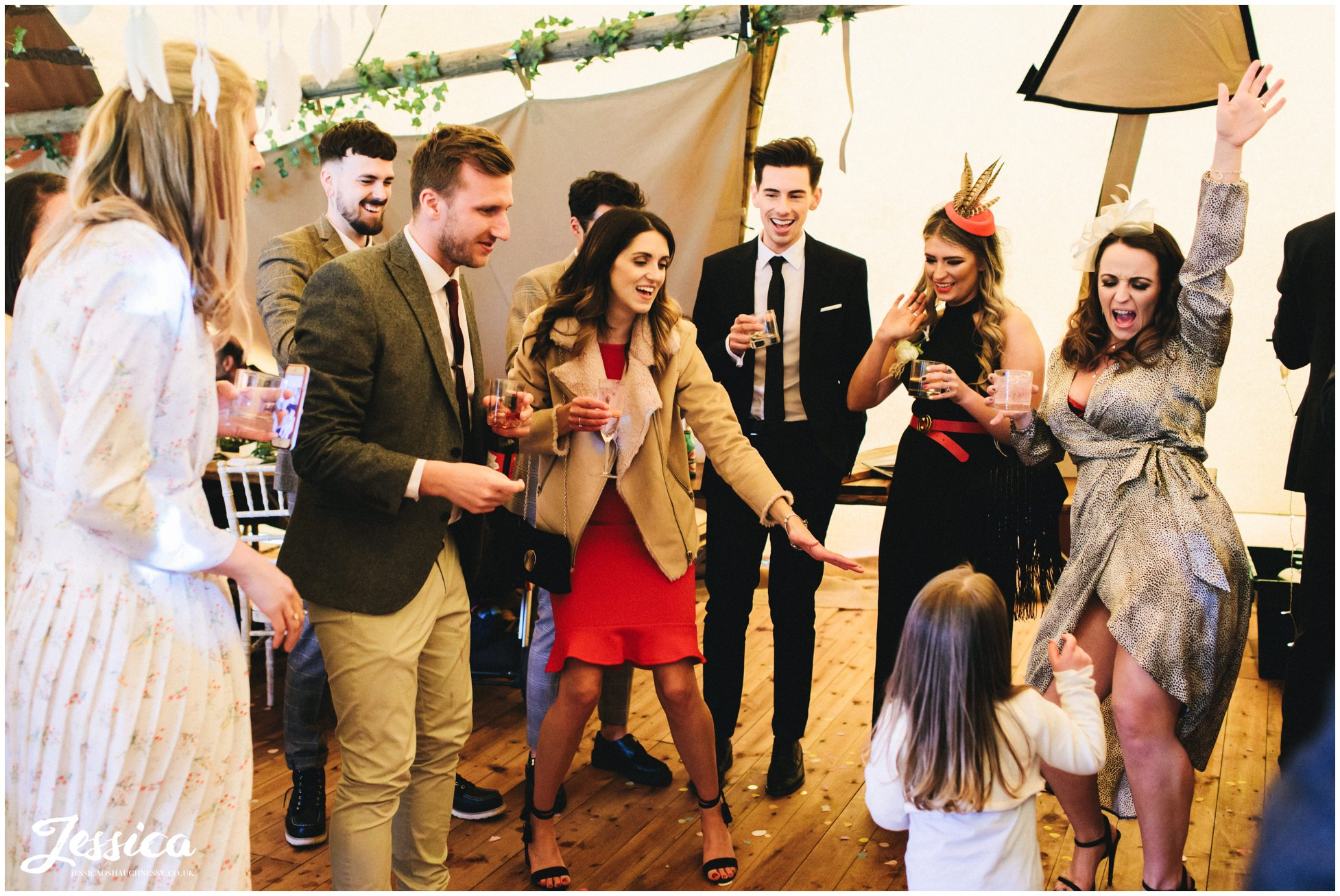 wedding guests cheer on child as she sings and dances to frozen