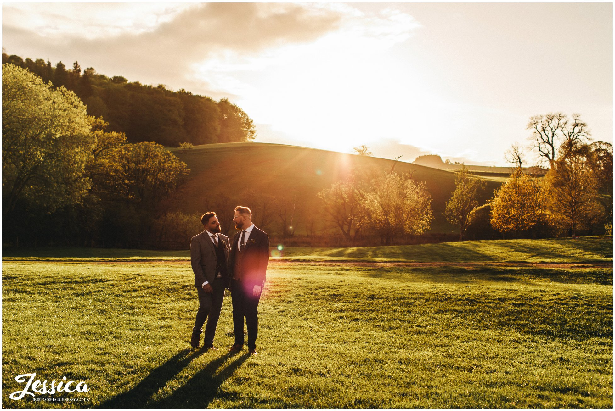 grooms take an walk in the evening sunlight