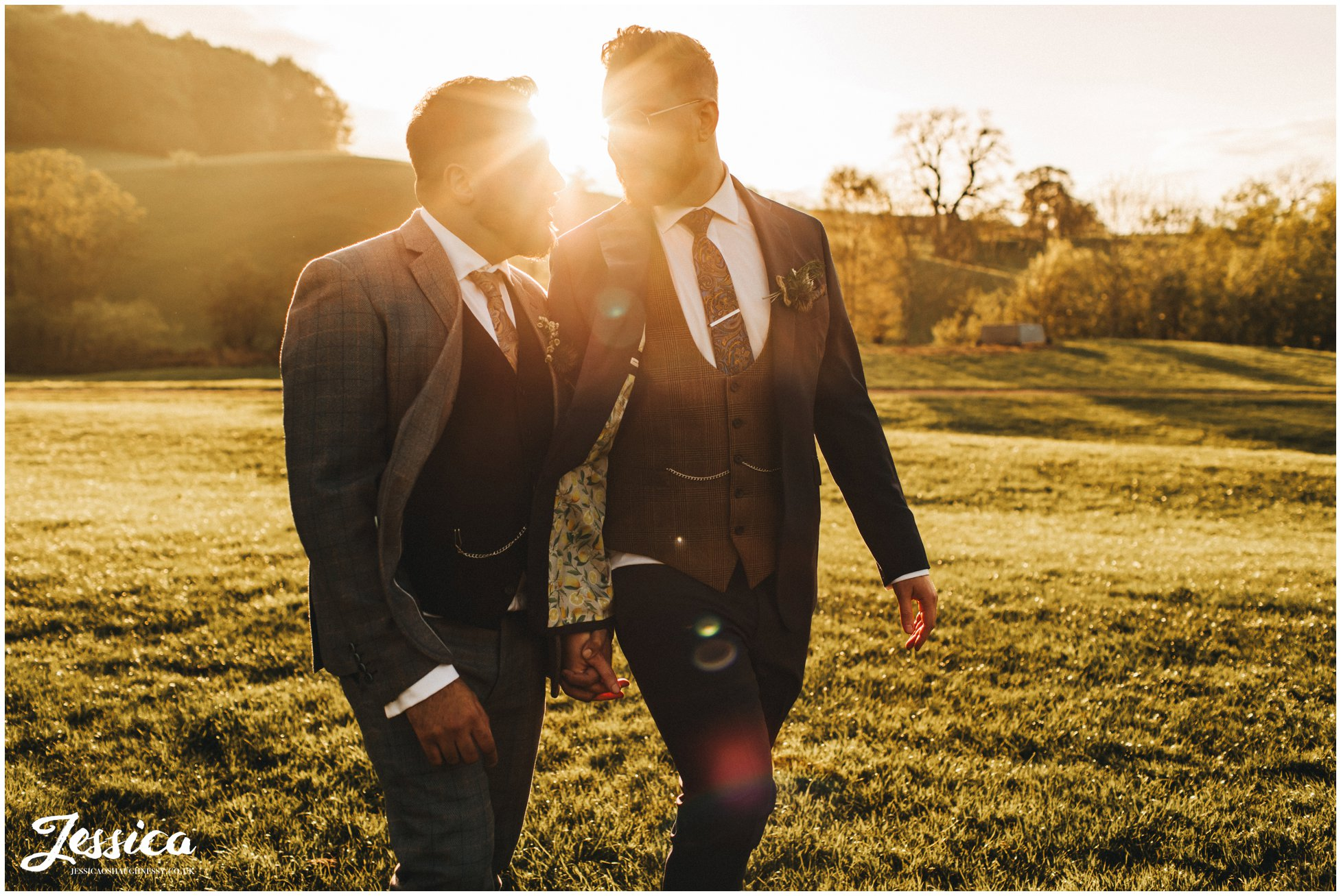 Groom's walk through the field together in the evening