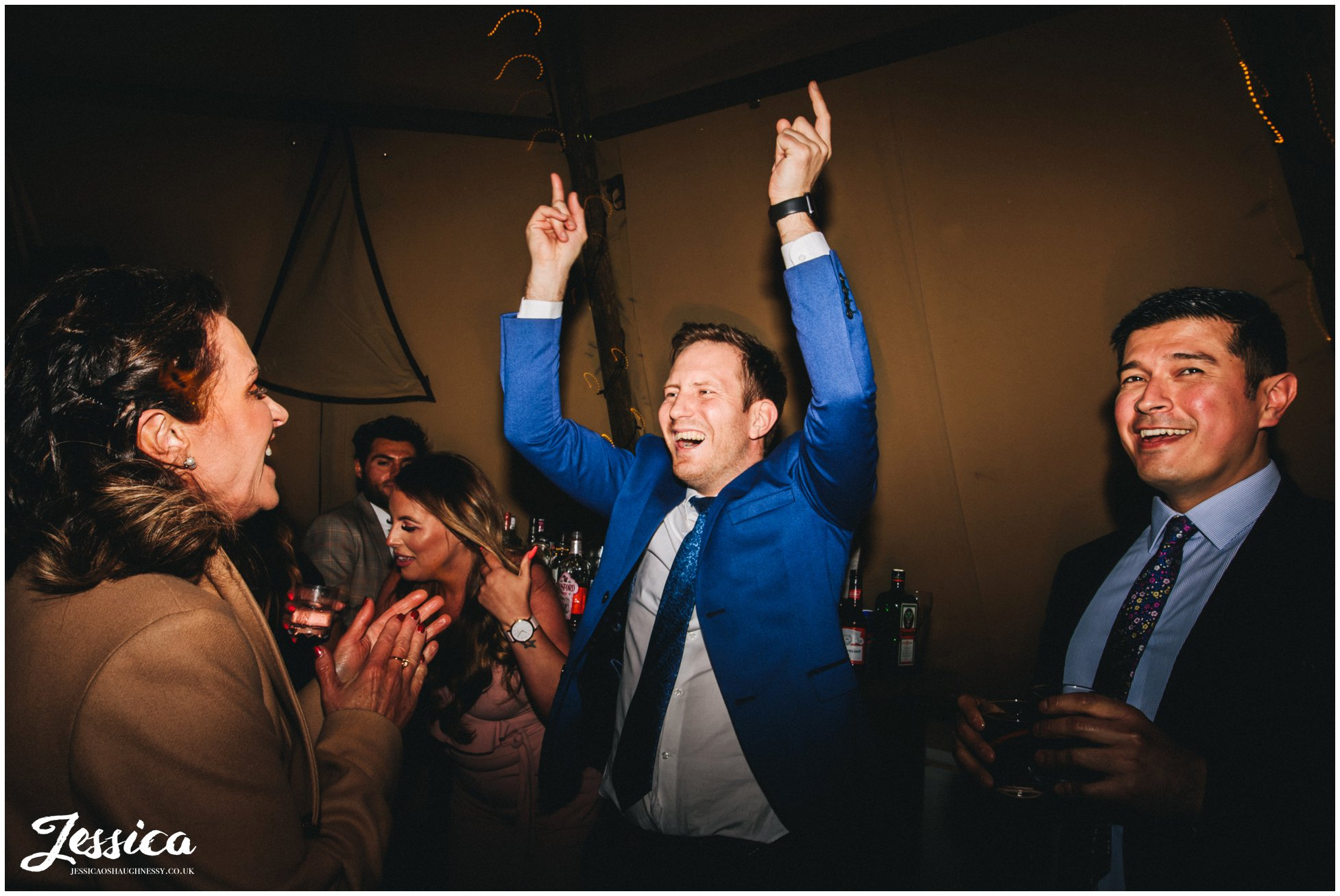 guest throw hands in the air on the tipi dancefloor