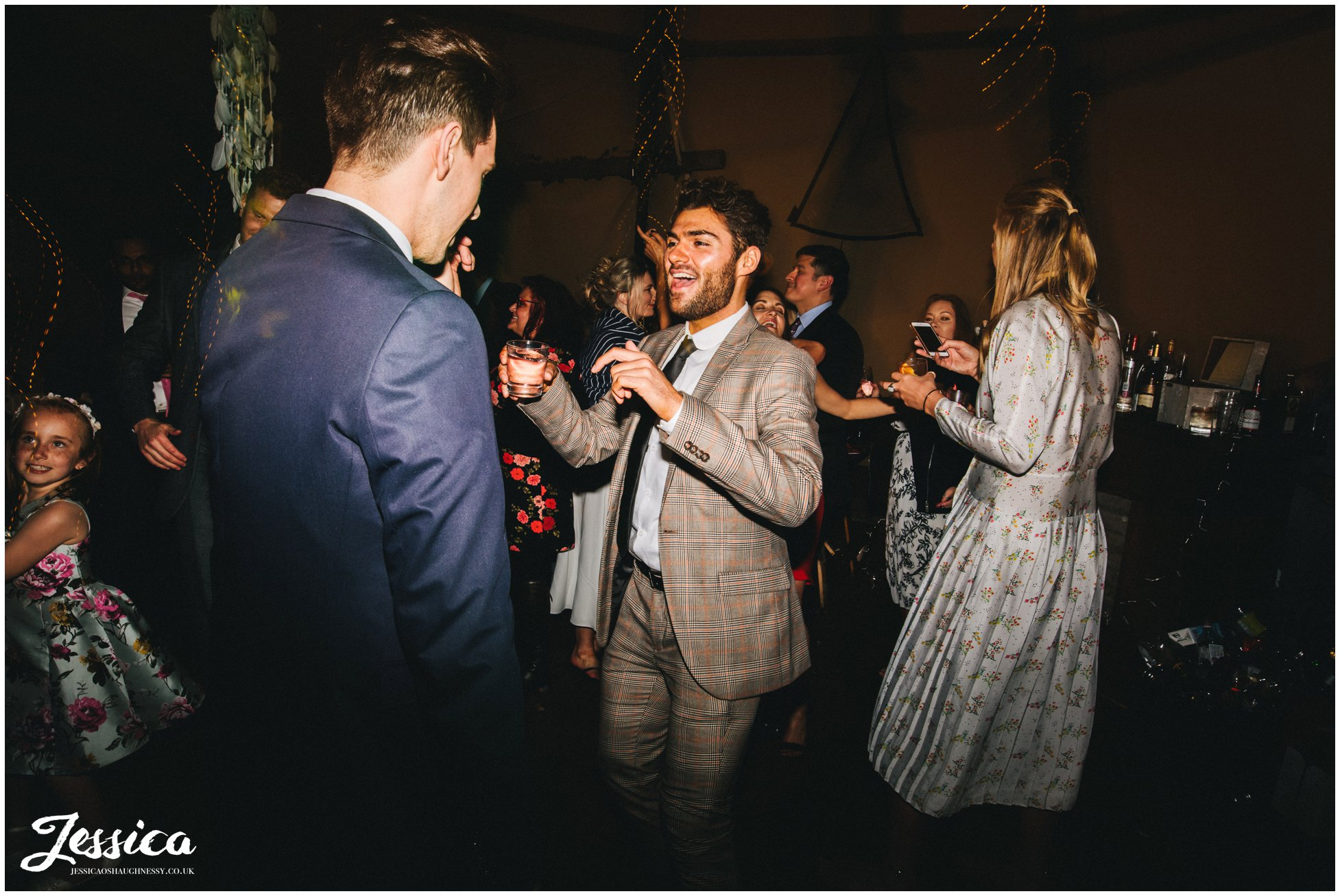 wedding guests enjoy the music at the lake district wedding
