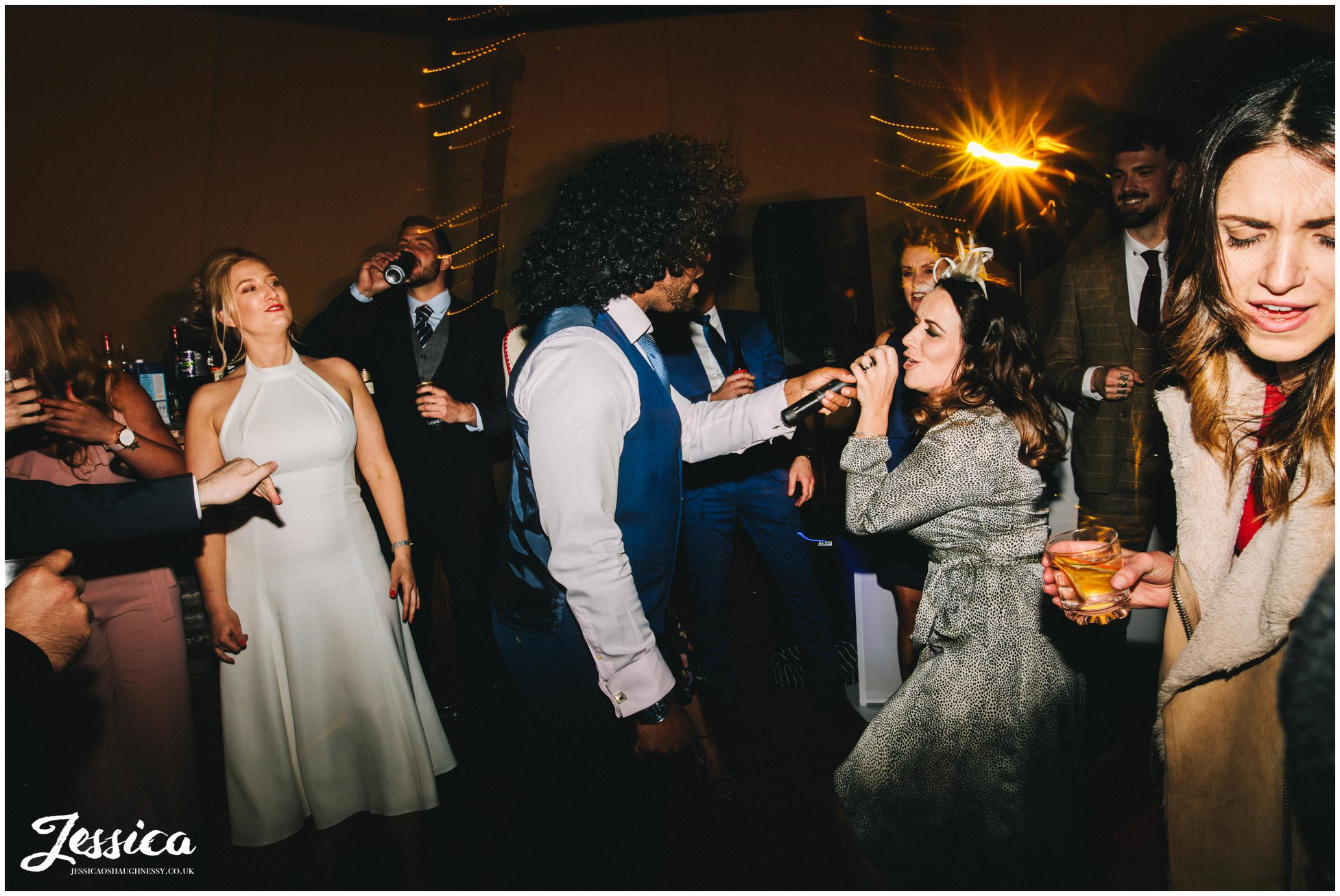 DJ brings microphone onto the dancefloor for guests to sing