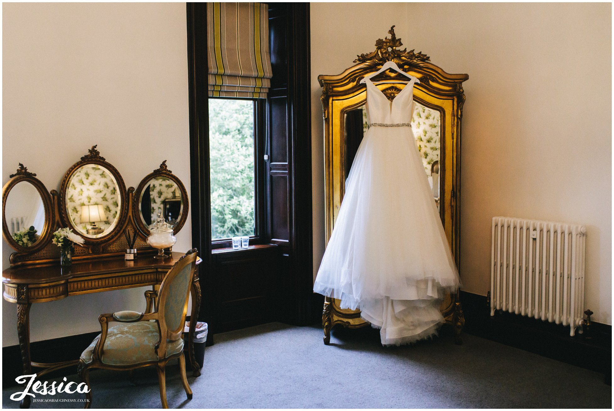 wedding dress hanging in tyn dwr halls bridal suite