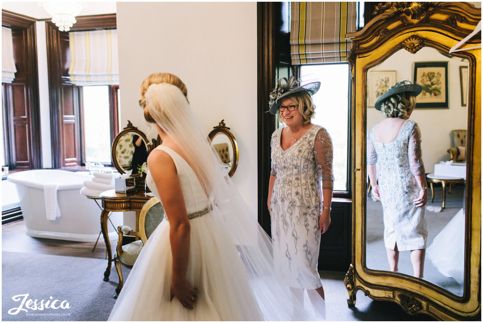 mother of the bride admires her daughter