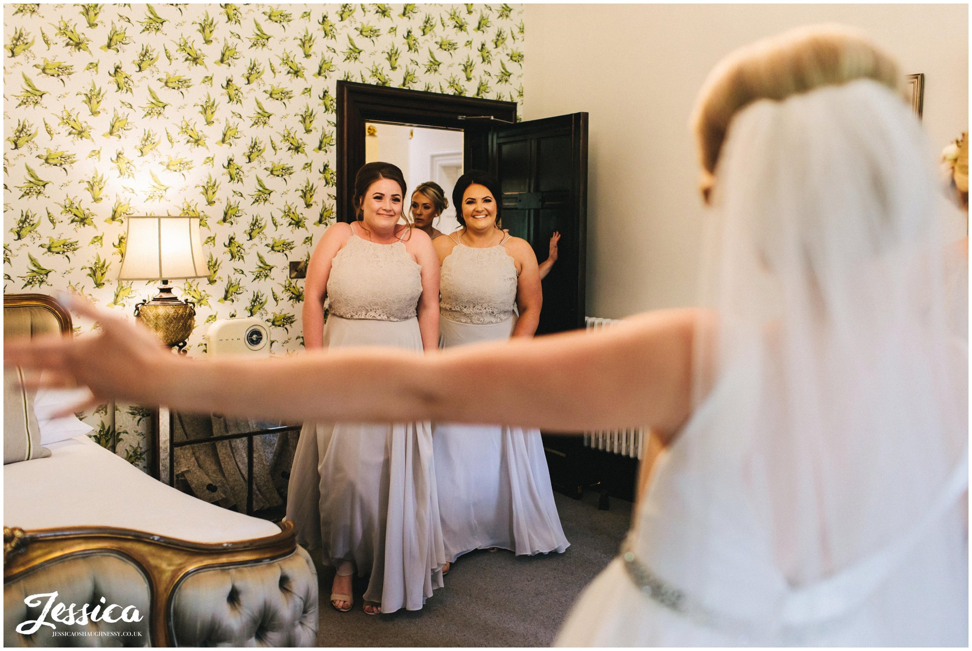 bride reveals dress to her bridesmaids