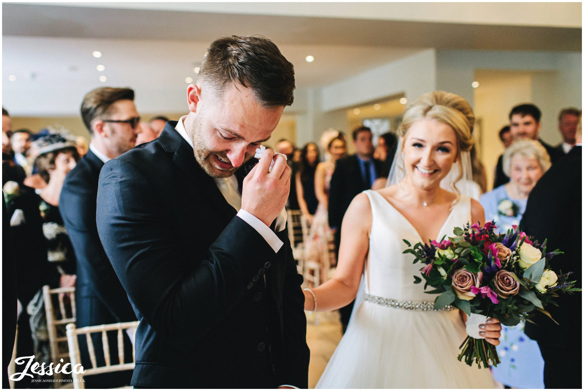 groom cries as he see's the bride for the first time