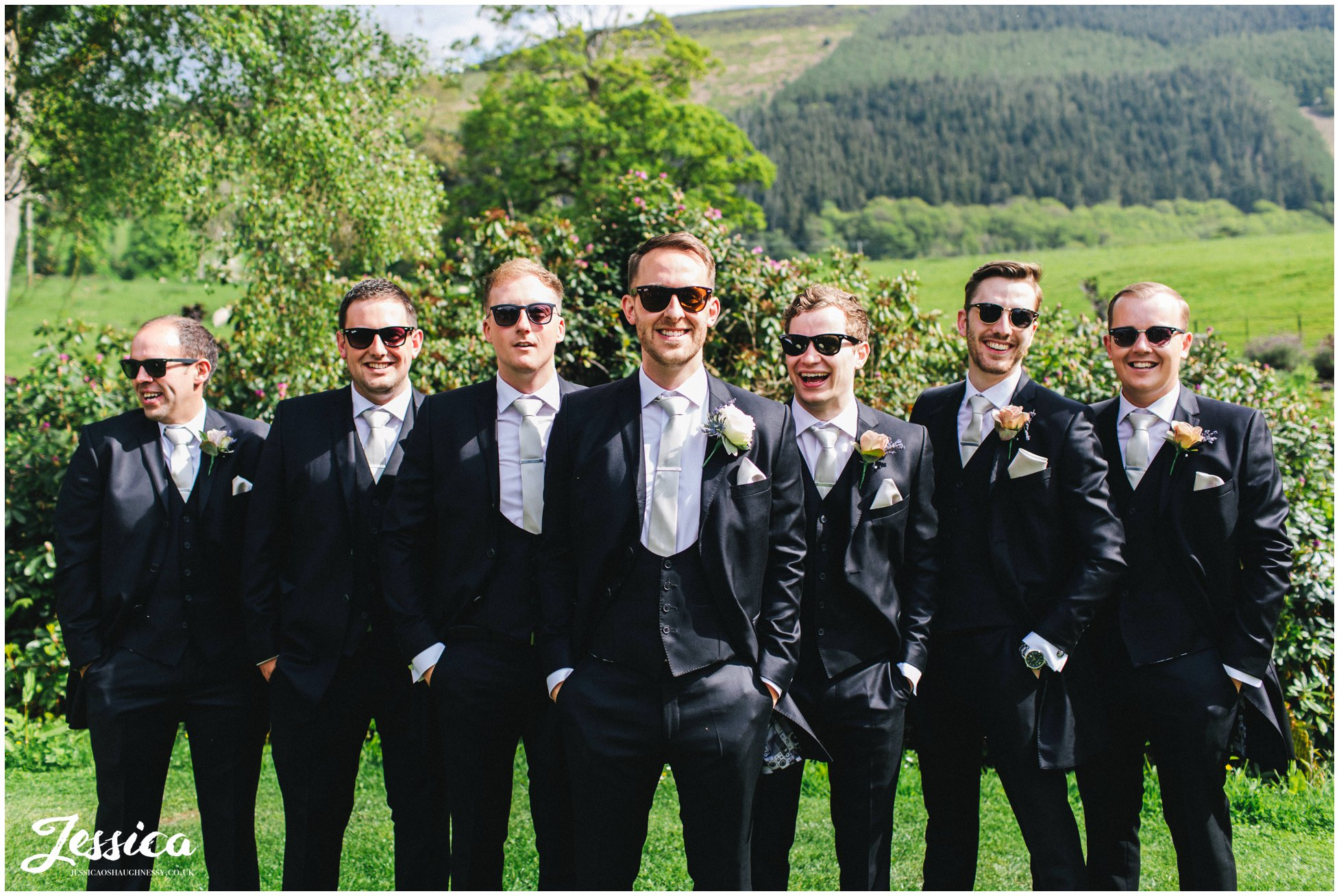 groom & groomsmen pose with sunglasses