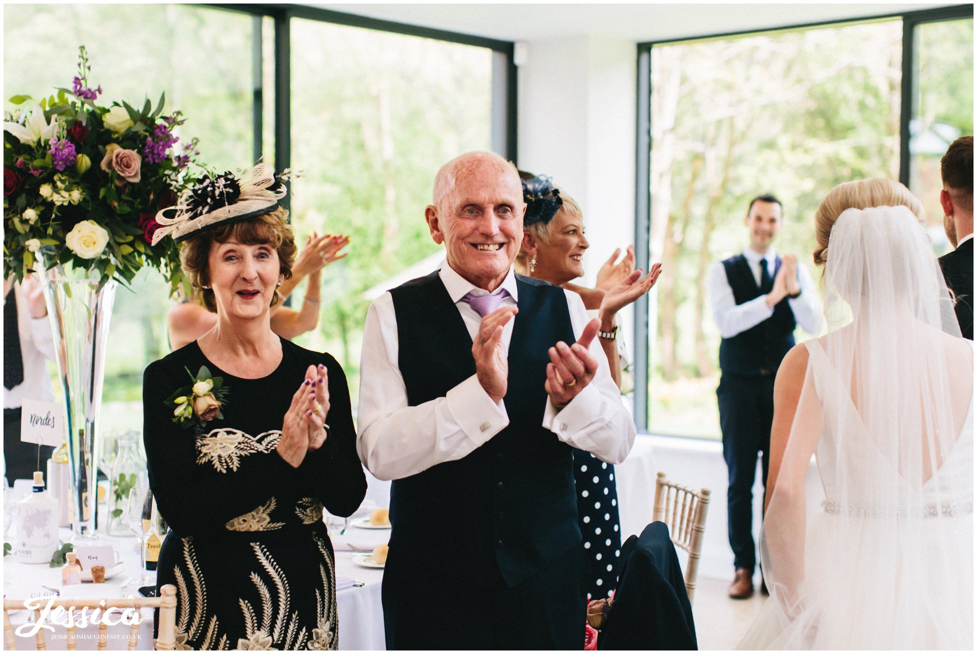 guests cheer as the couple enter