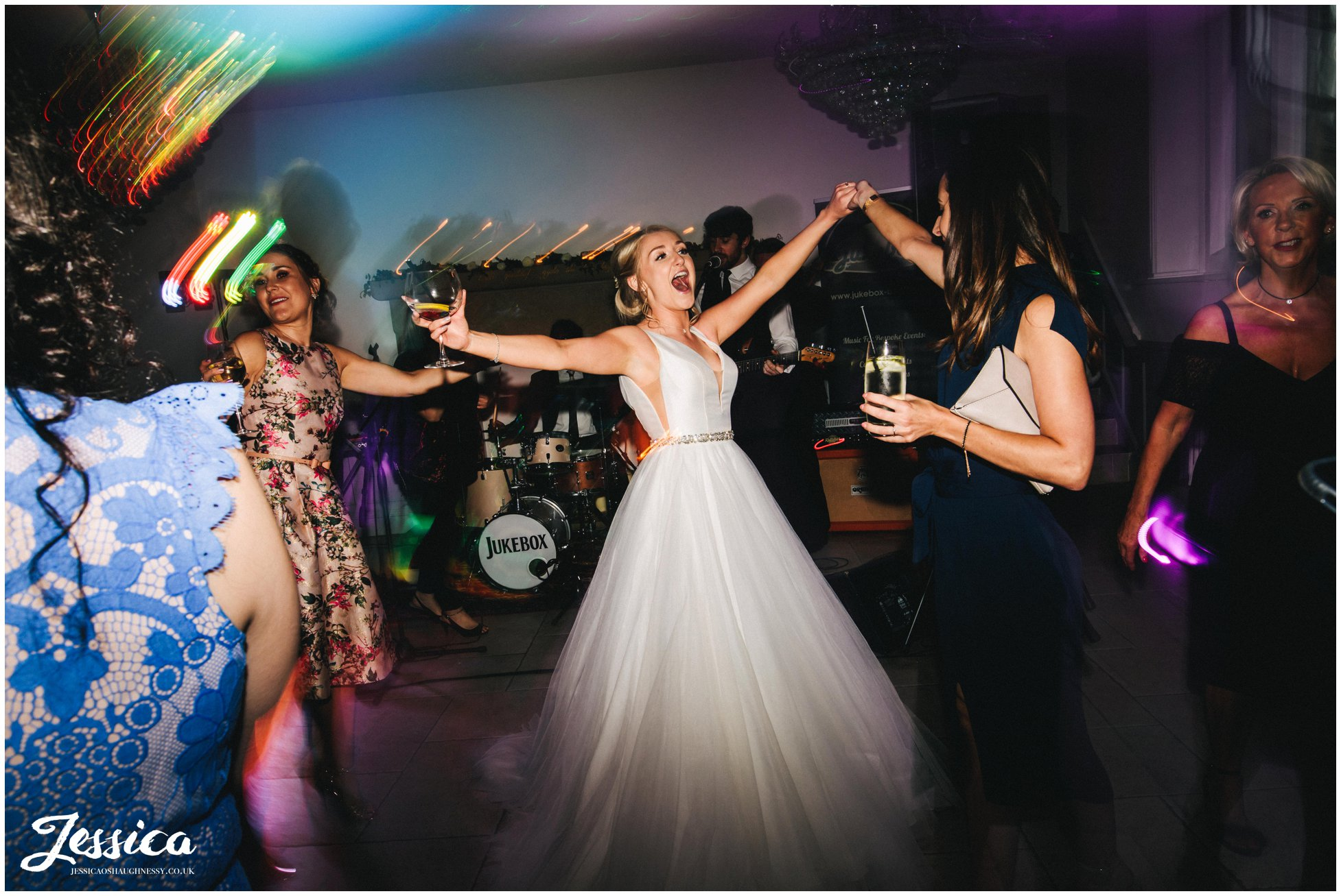 bride dances with her friends at tyn dwr hall in north wales