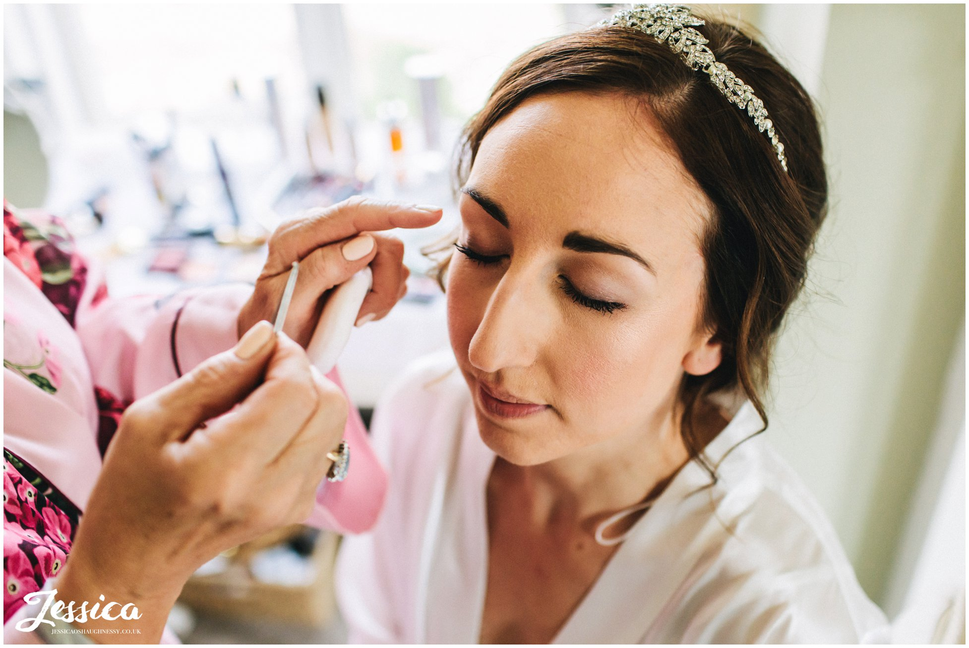 bride has her makeup applied