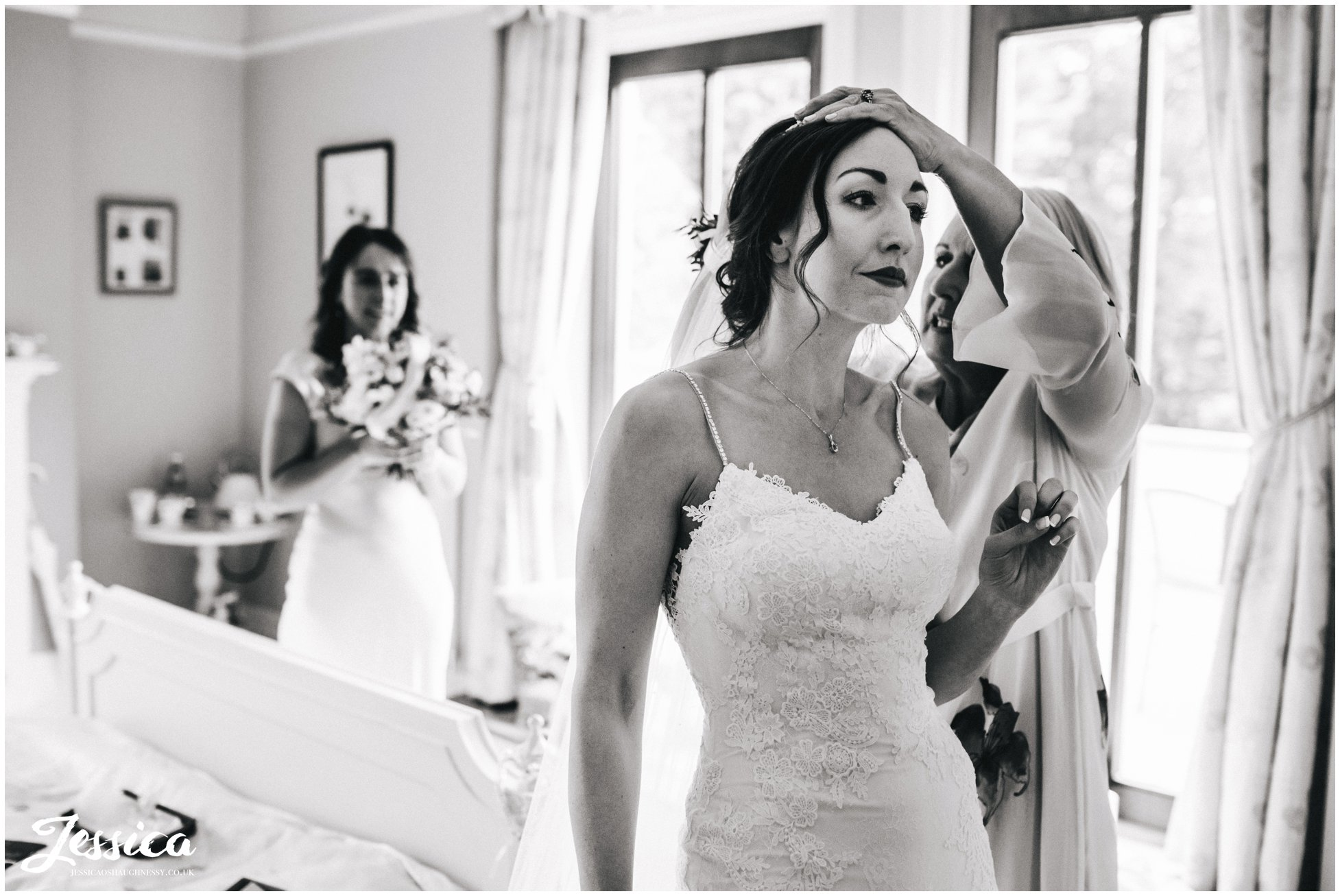 the bride has her veil put in ready for the wirral ceremony