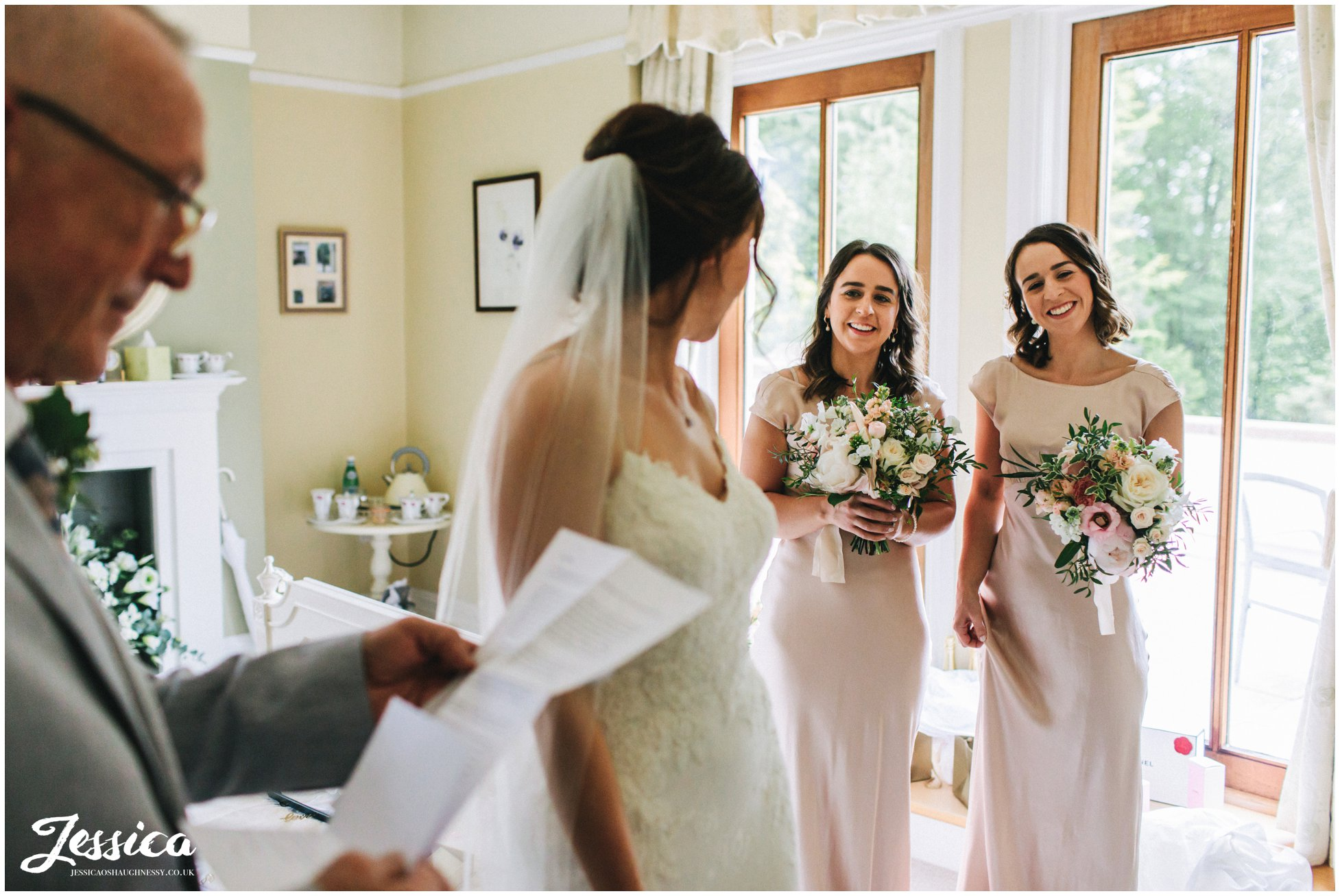 bridesmaids smile as father of the bride reads letter from his daughter