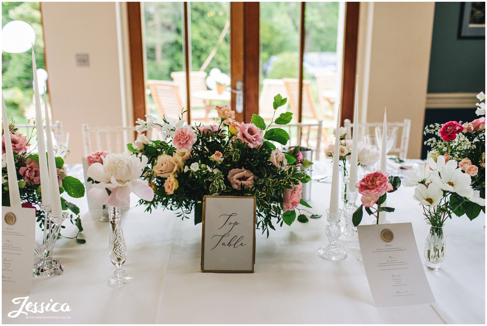 pink florals decorate the wedding tables