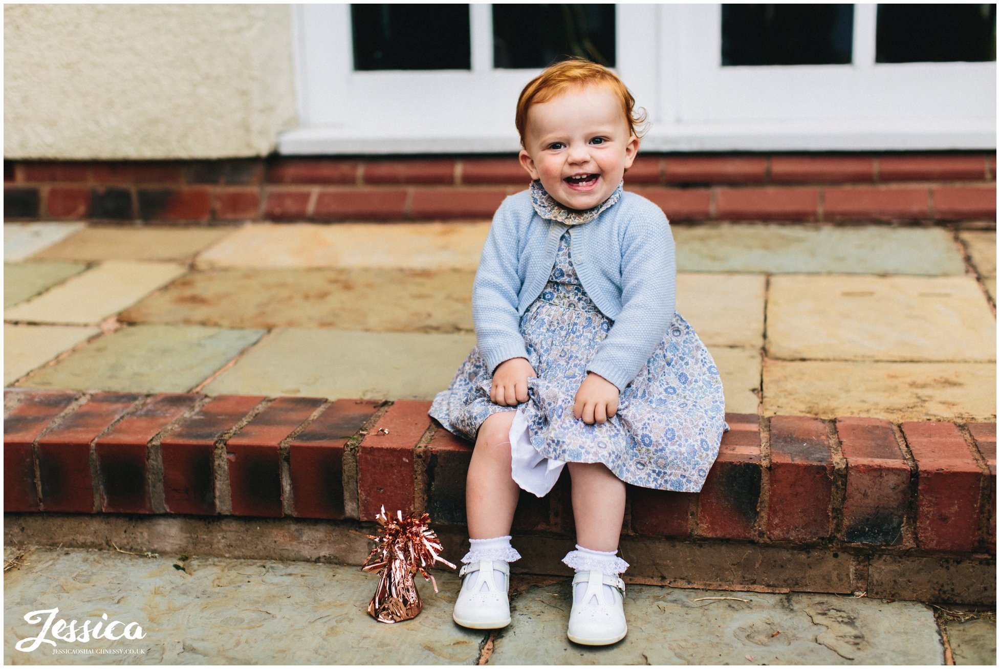 child giggles at mere brook house, wirral wedding