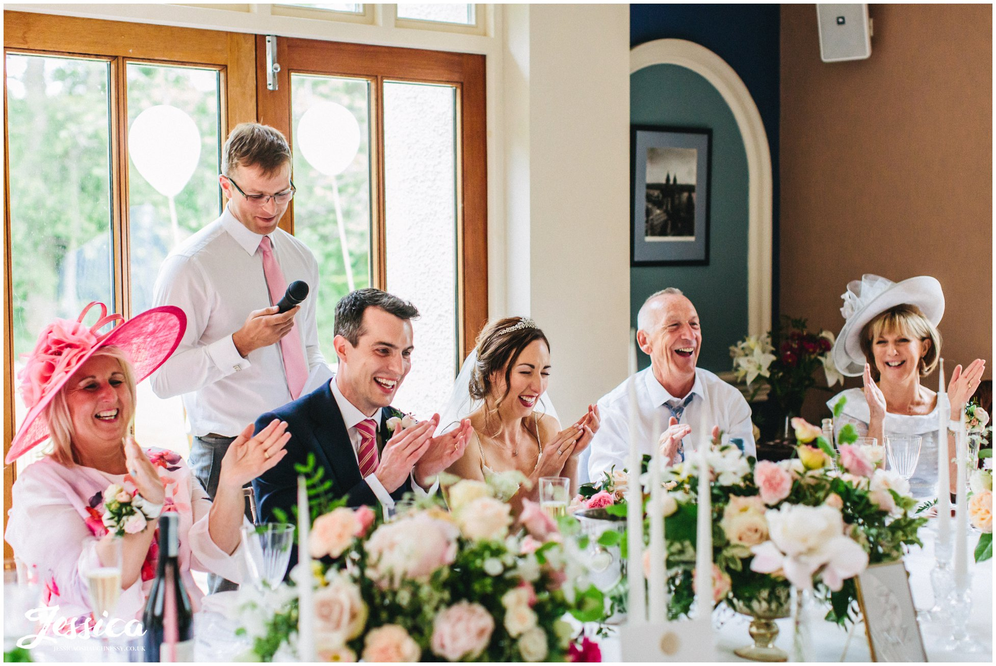 the top table applaud the best man after his gives his speech