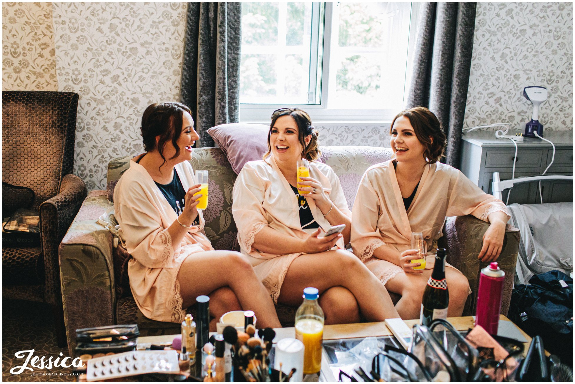 bridesmaids drink prosecco on the morning of the wedding