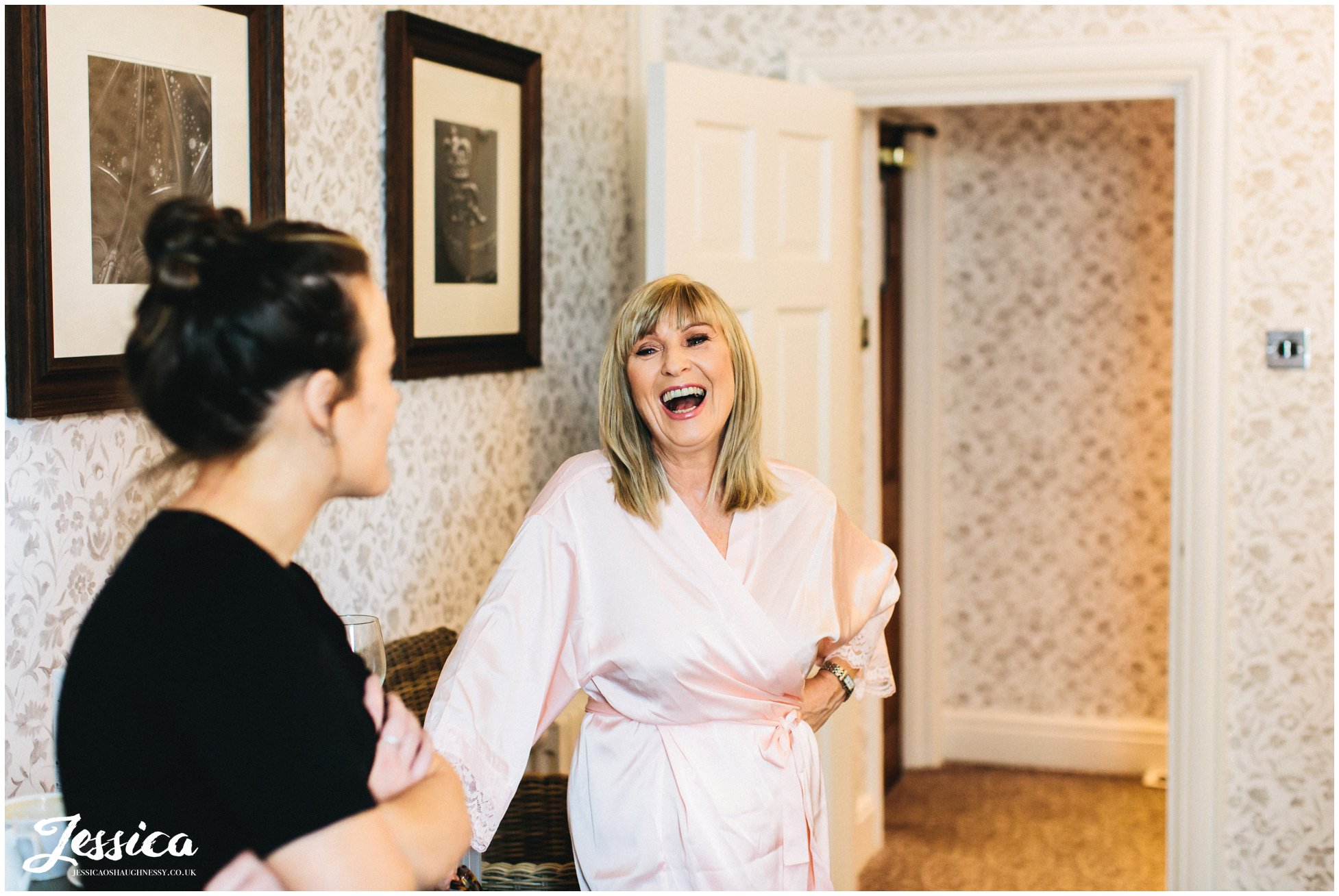 mother of the bride laughs during bride prep