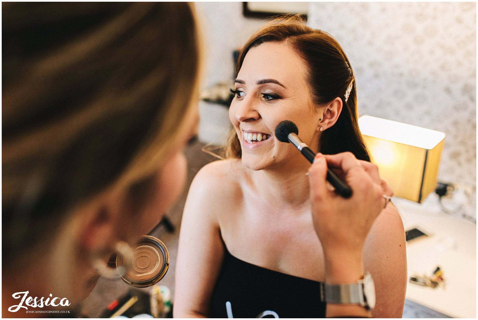 bride gets make up done for mottram hall wedding