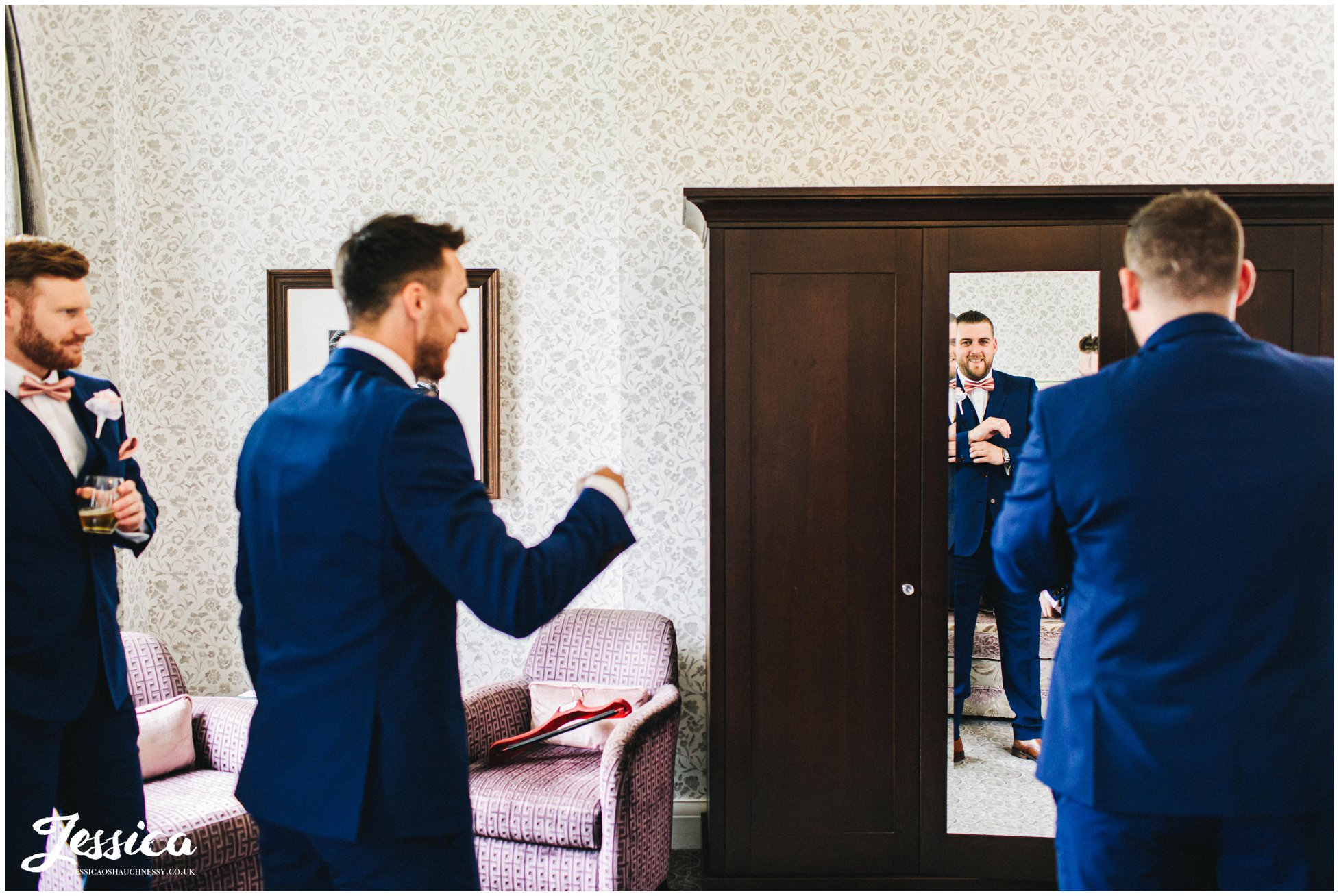 groomsmen get ready in a mottram hall suite