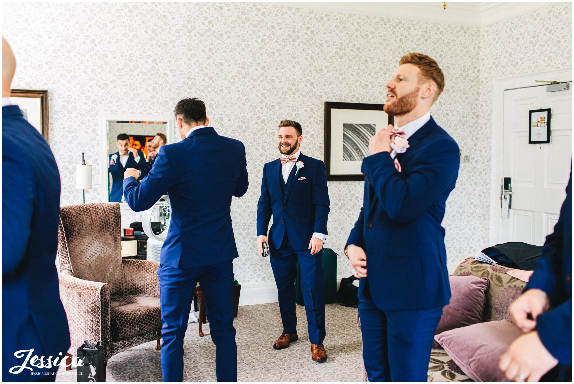 the groom & groomsmen are dressed ready for the wedding at mottram hall