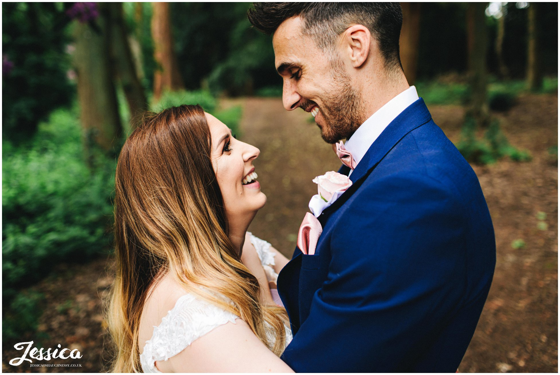 husband and wife smile to each other after their wedding ceremony
