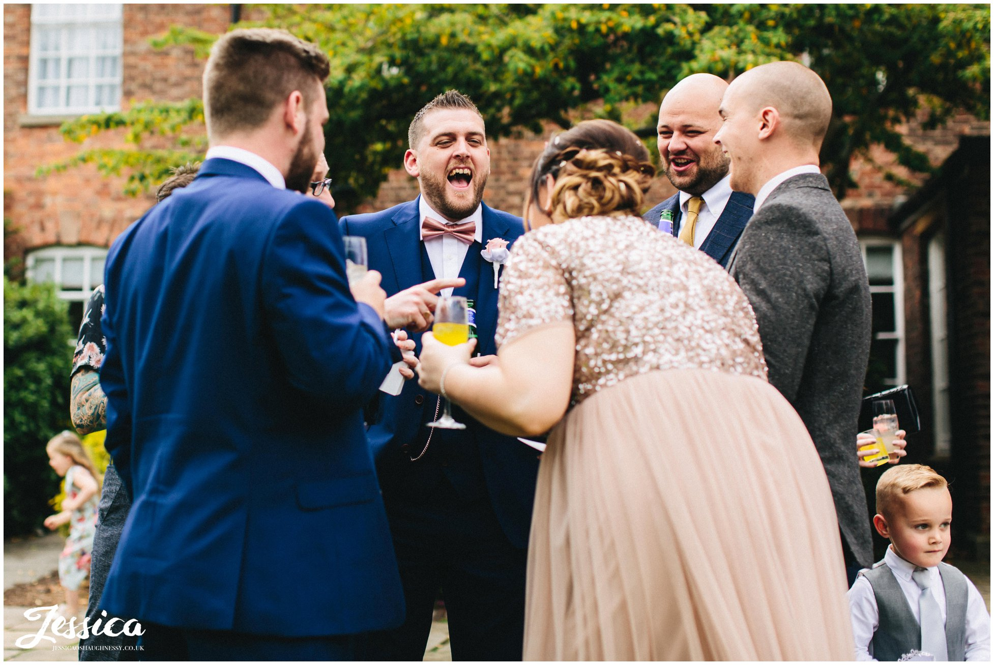 best man laughs outside mottram hall