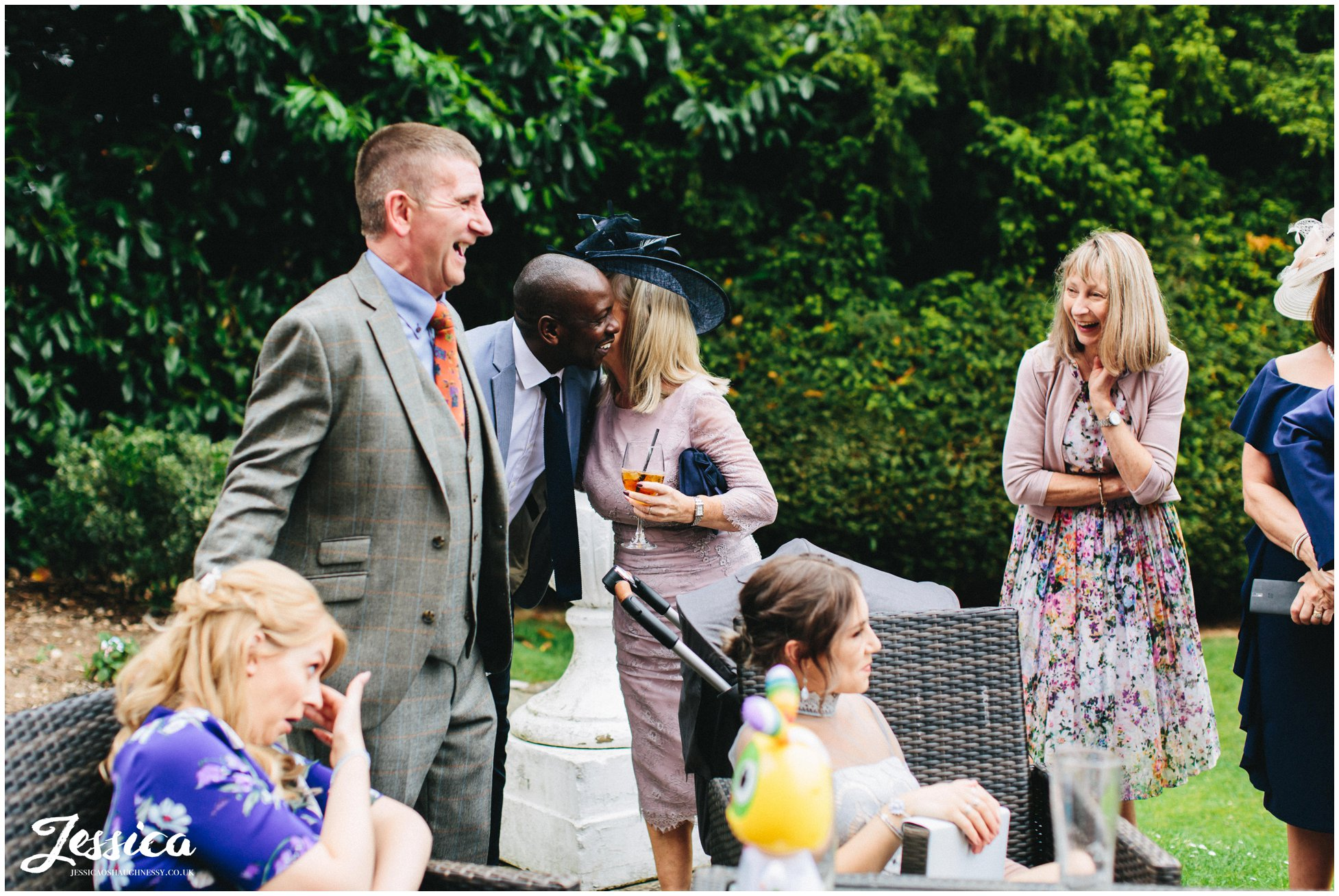 guests enjoy the nice weather at mottram hall wedding in cheshire