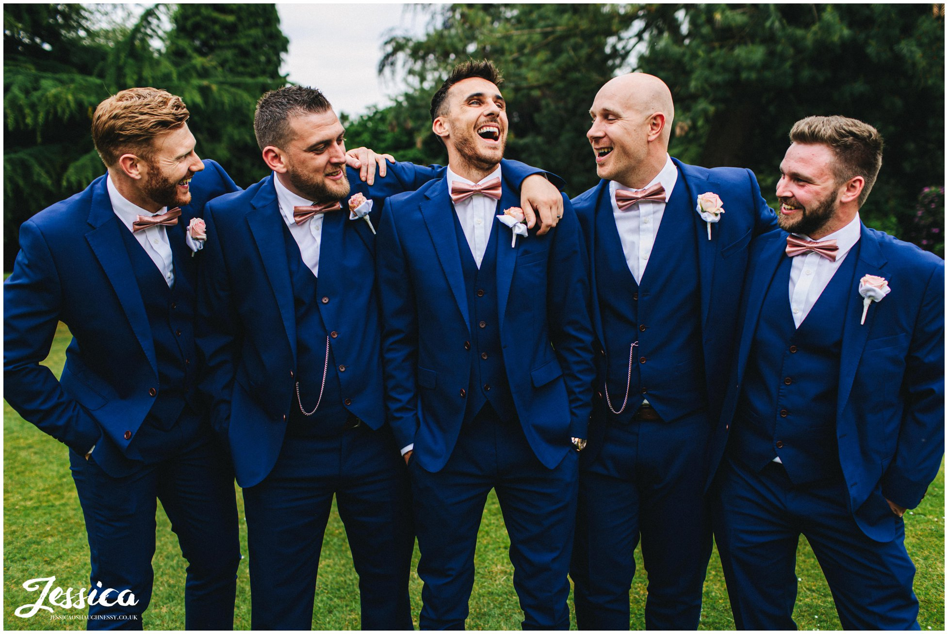 groom & groomsmen pose for group photograph
