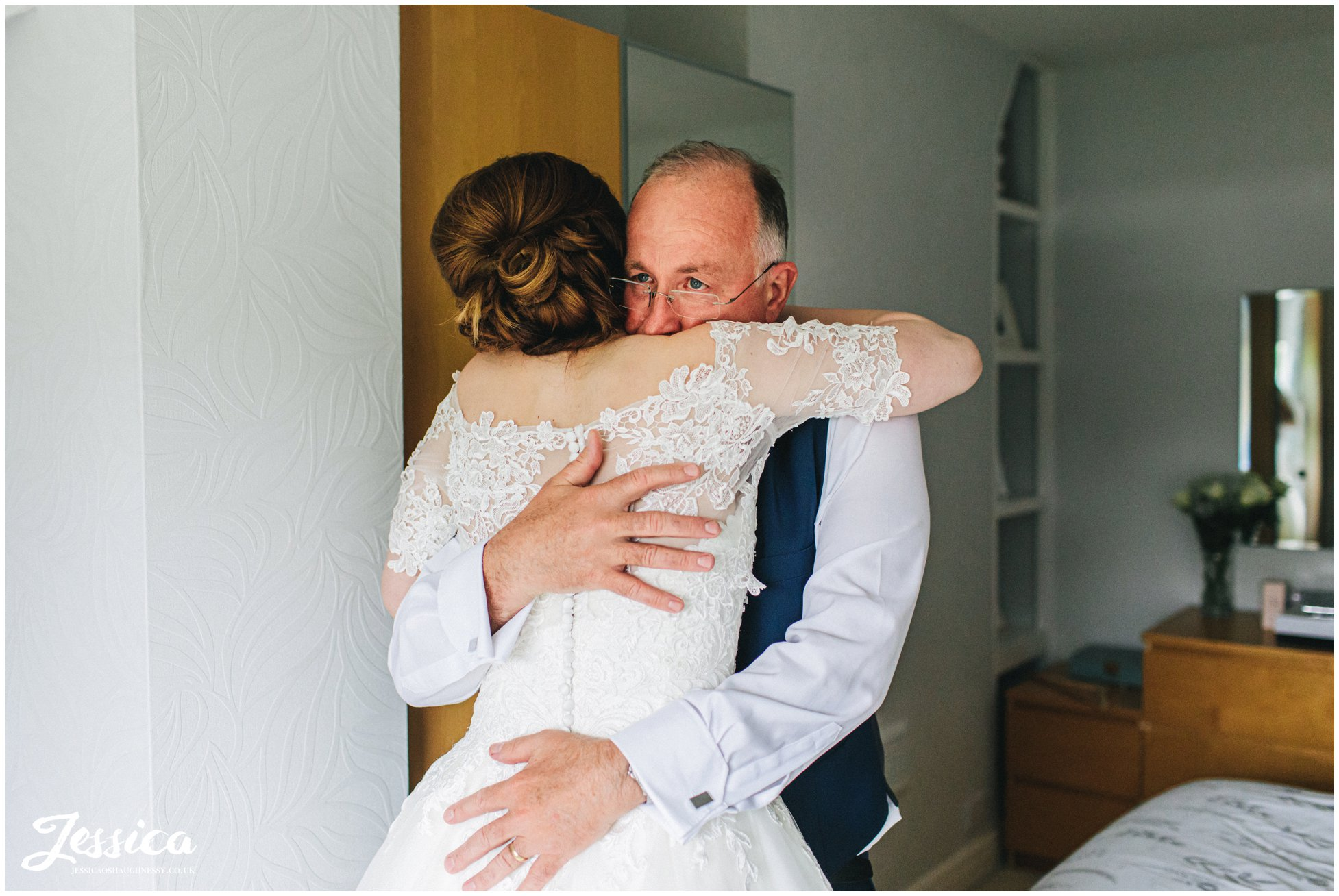 father of the bride cries seeing his daughter in her dress