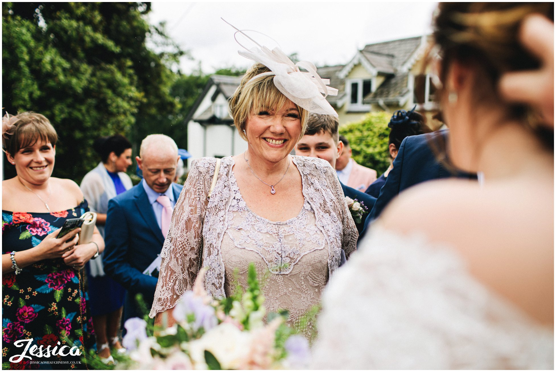 mother of the groom smiles at daughter-in-law