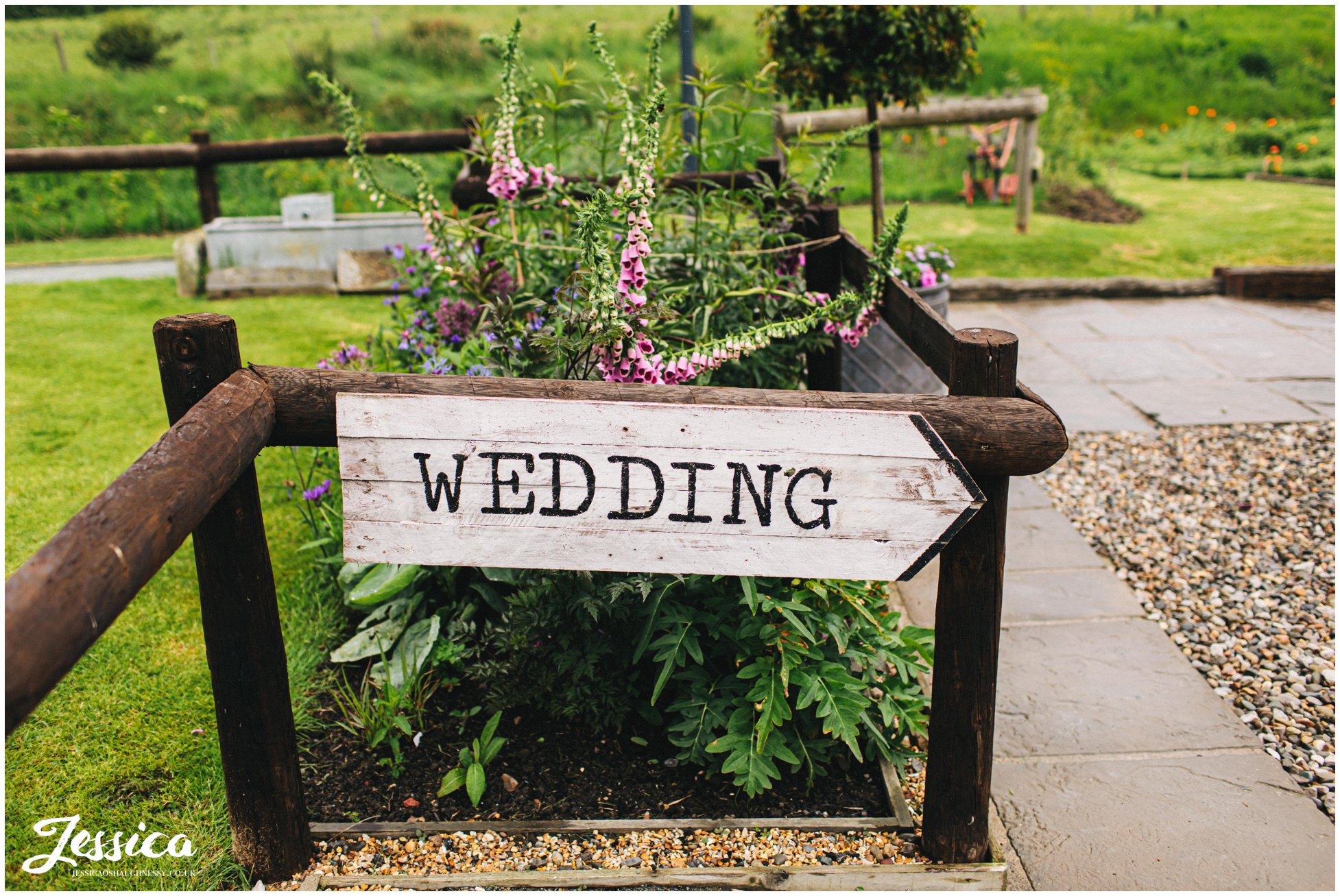 wedding sign directs guests to the reception