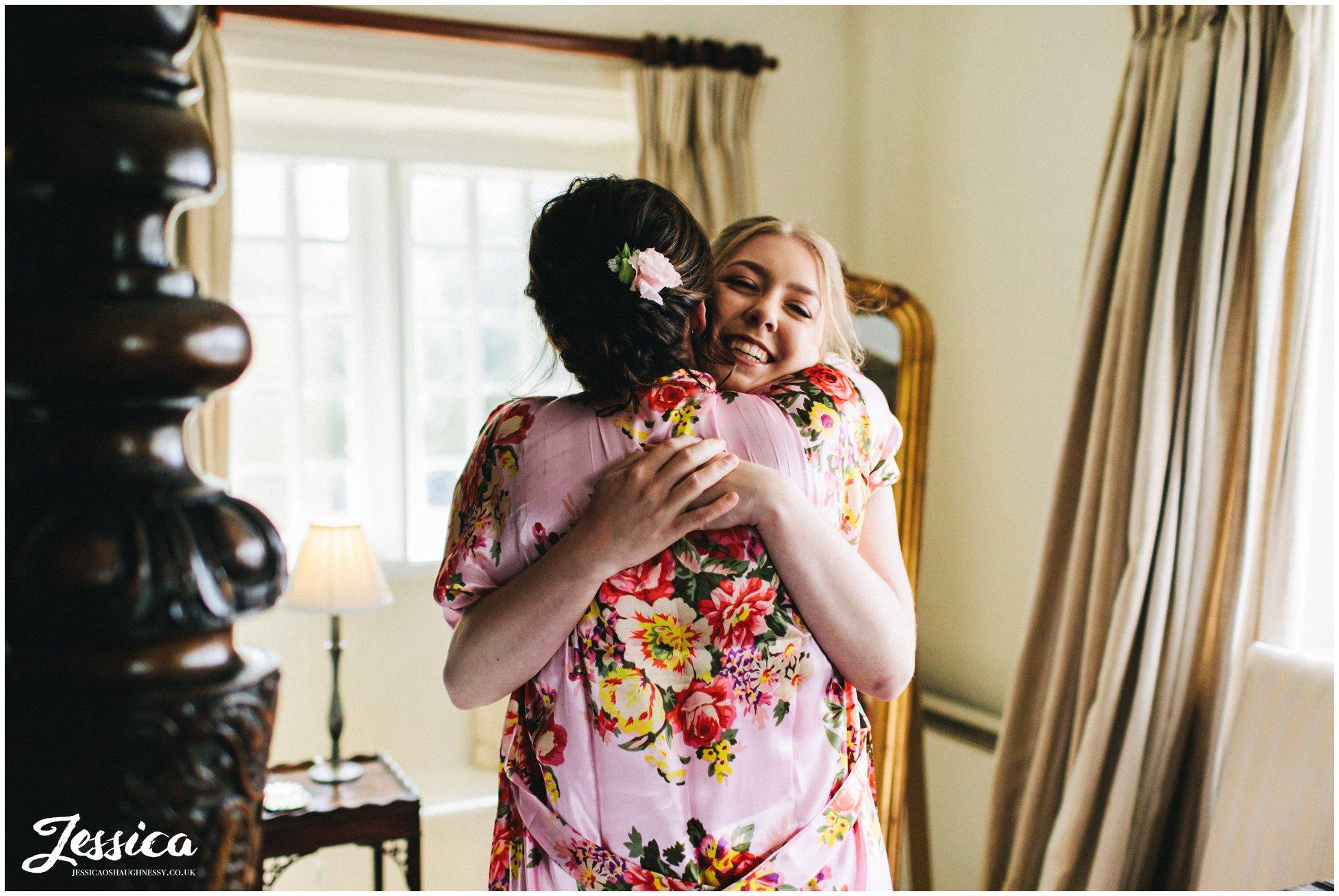 bridesmaids hug on the wedding morning