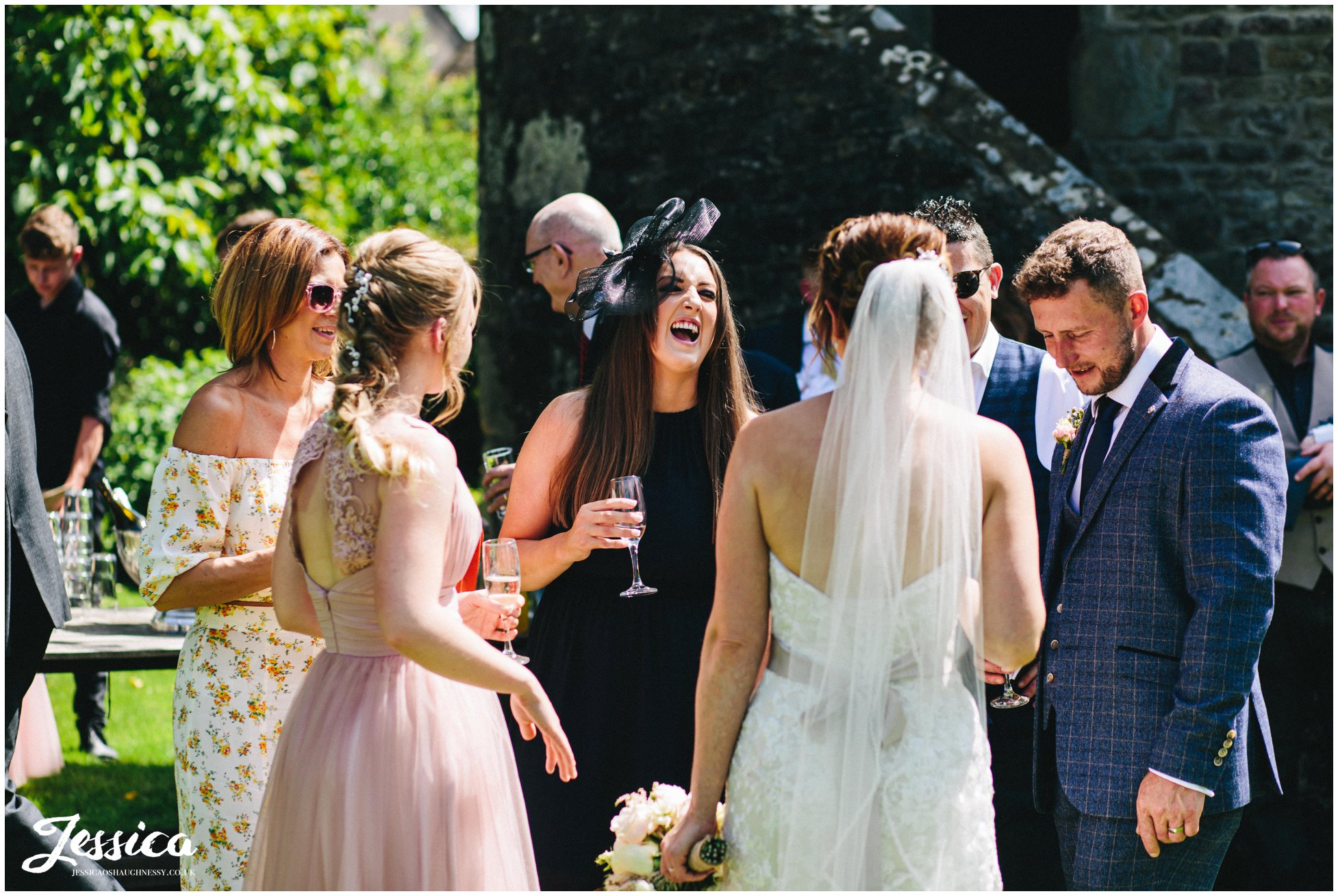 guests laughing during champagne reception