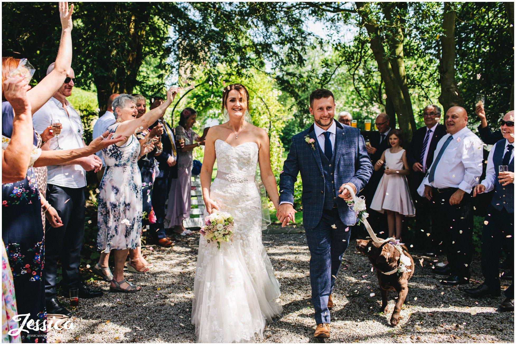 newly wed's walk through confetti line