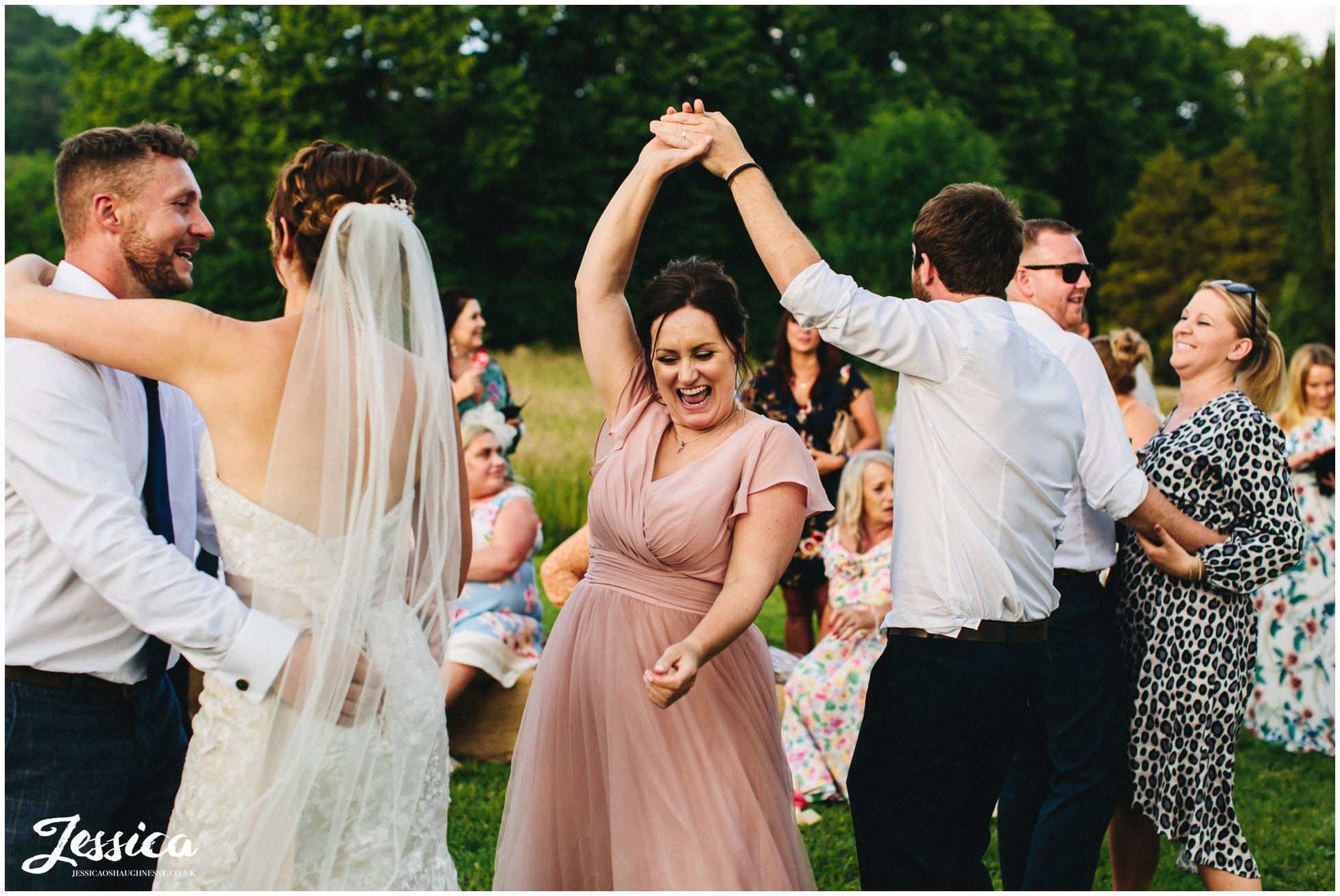 guests join the couple and dance outside on the lawn